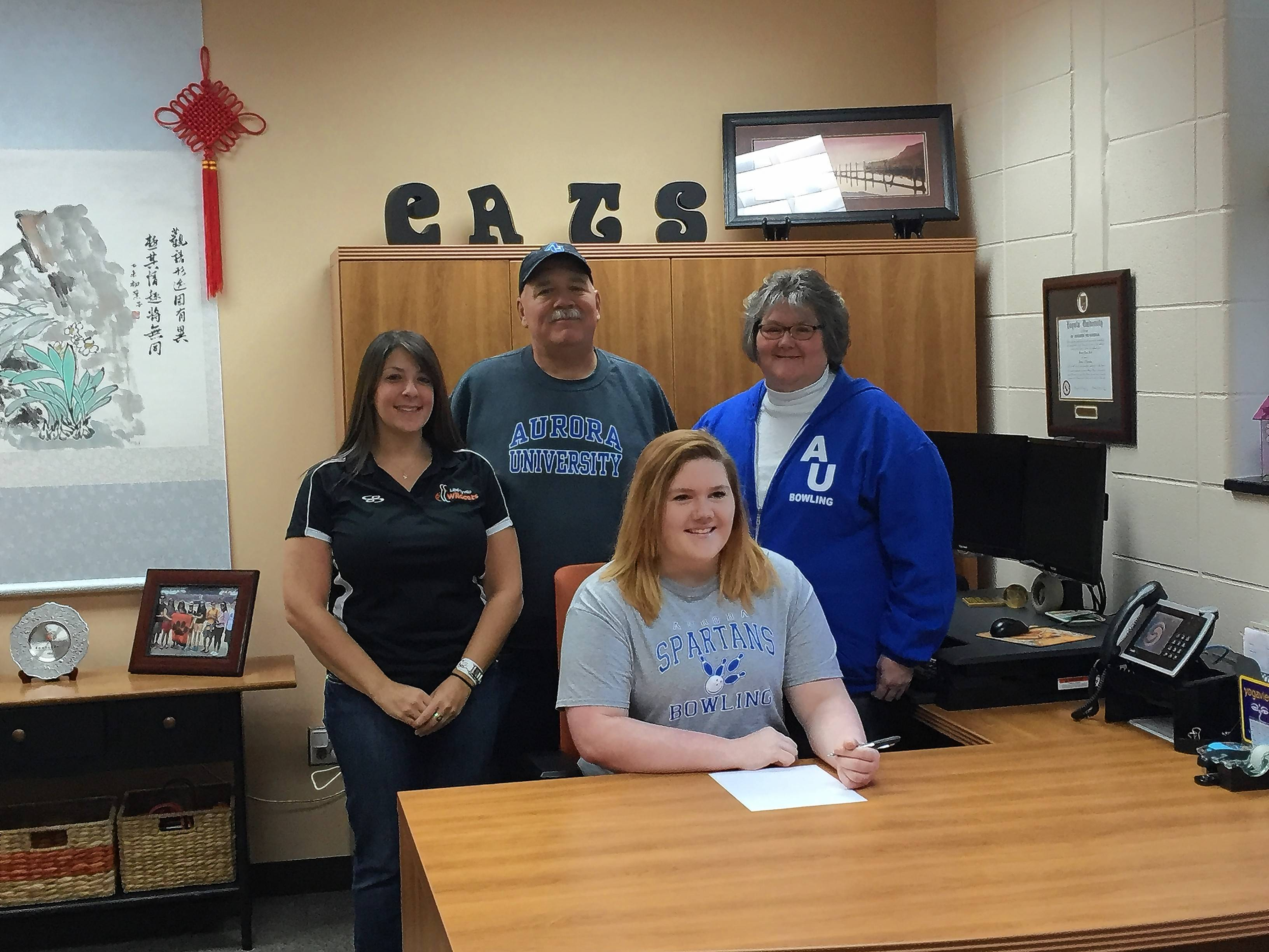 Libertyville's Emma Davellis is joined by her parents, Michael and Lynette, and coach Lindsey Siegel for her commitment to the Aurora University bowling program.
