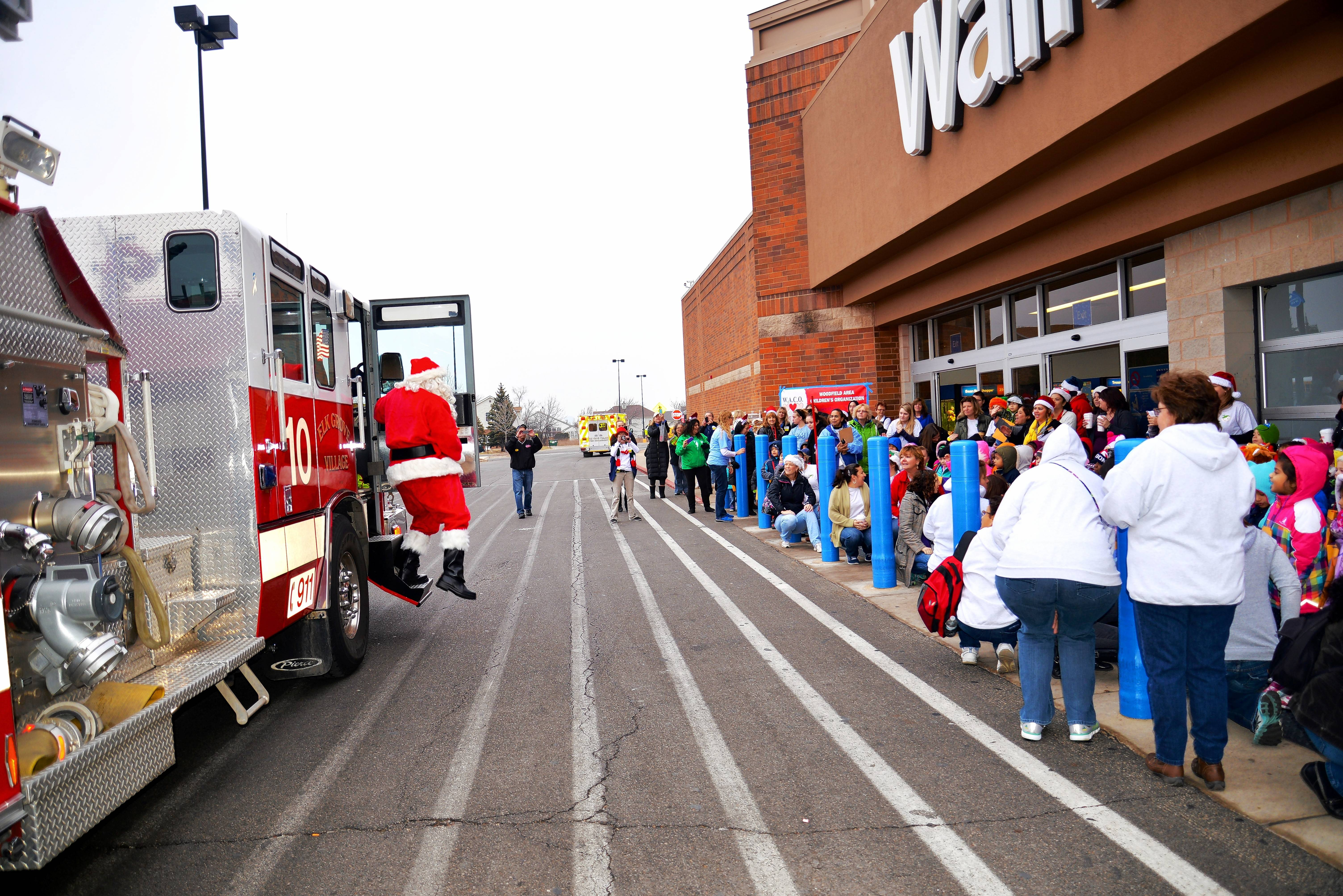 Santa arrives last December at the Elk Grove Village Wal-Mart, where hundreds of preschool kids get a chance to shop for Christmas presents thanks to the Woodfield Area Children's Organization.