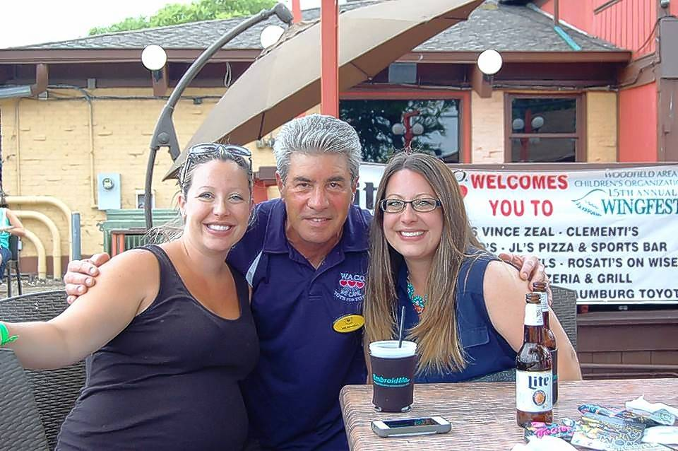 Woodfield Area Children's Organization President Bill Benedict is with two of his daughters, Julie Haberer and Jennie Appleby, in July at the group's 15-year-old Wingfest fundraiser in Schaumburg.