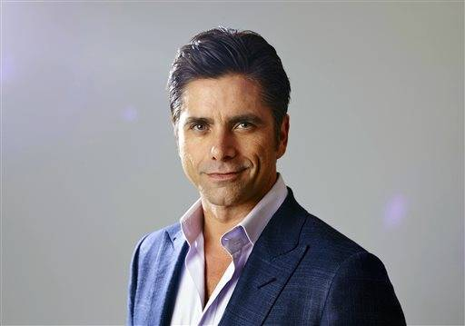 "FILE - In this Aug. 6, 2015 file photo, actor John Stamos, from the new comedy ""Grandfathered,"" poses for a portrait during the Fox 2015 Television Critics Association Summer Press Tour in Beverly Hills, Calif. An attorney for Stamos entered a no contest plea on Tuesday, Nov. 24, 2015, to a misdemeanor charge of driving under the influence of a drug filed after the actor's arrest in Beverly Hills in June. A Los Angeles judge sentenced Stamos to three years on probation and attend 52 Alcoholics Anonymous meetings. (Photo by Matt Sayles/Invision/AP, File)"