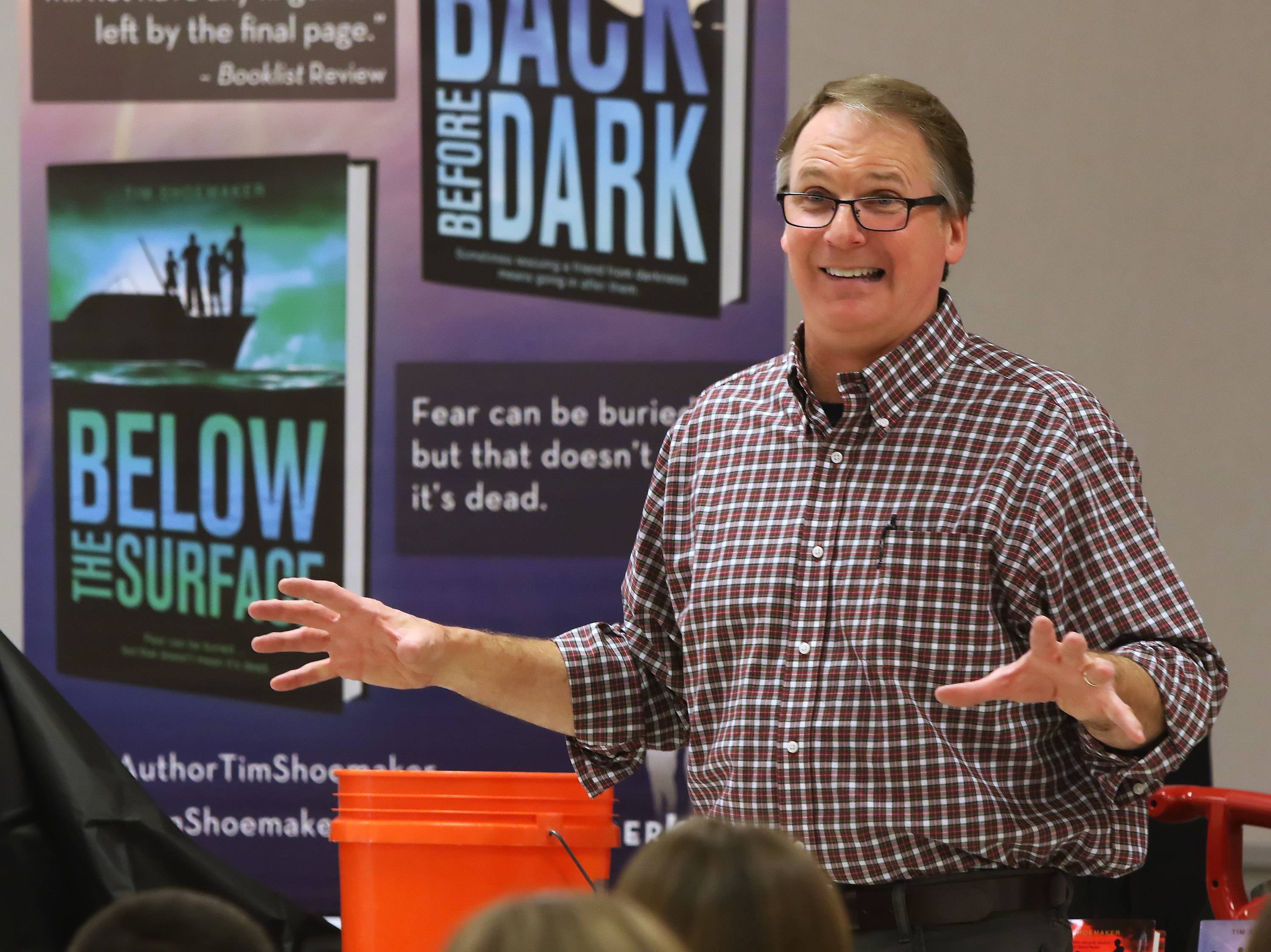 Author Tim Shoemaker speaks to students about being a hero Tuesday at Stanton School in Fox Lake. Shoemaker writes mystery books intended for middle school students.