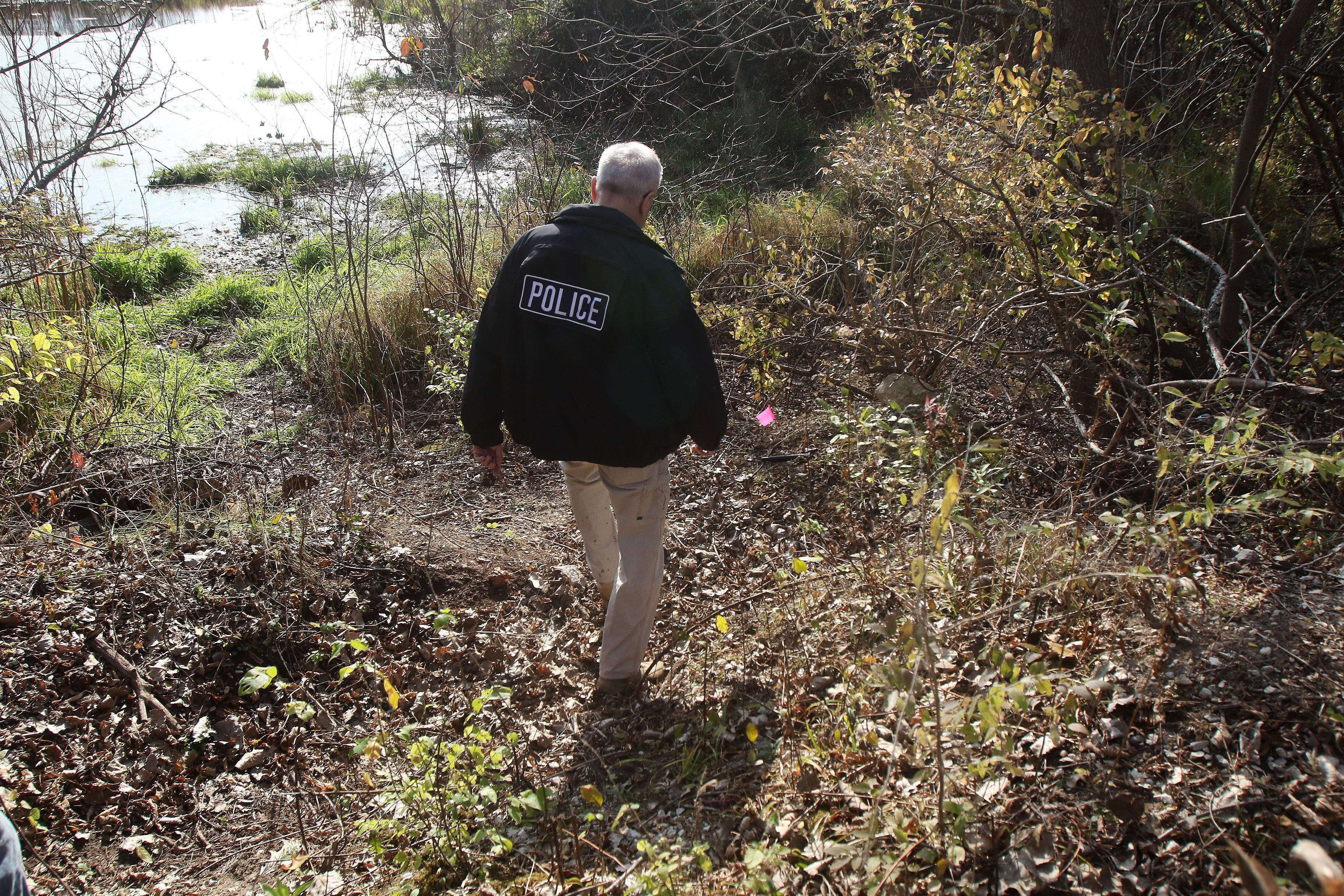 Lake County Major Crimes Task Force Cmdr. George Filenko retraces the footsteps of Fox Lake police Lt. Joe Gliniewicz near a pond on the day he staged his suicide. Filenko explained what police officers found as they responded to his call for help and what led to a major manhunt for suspects in the wooded area in Fox Lake.