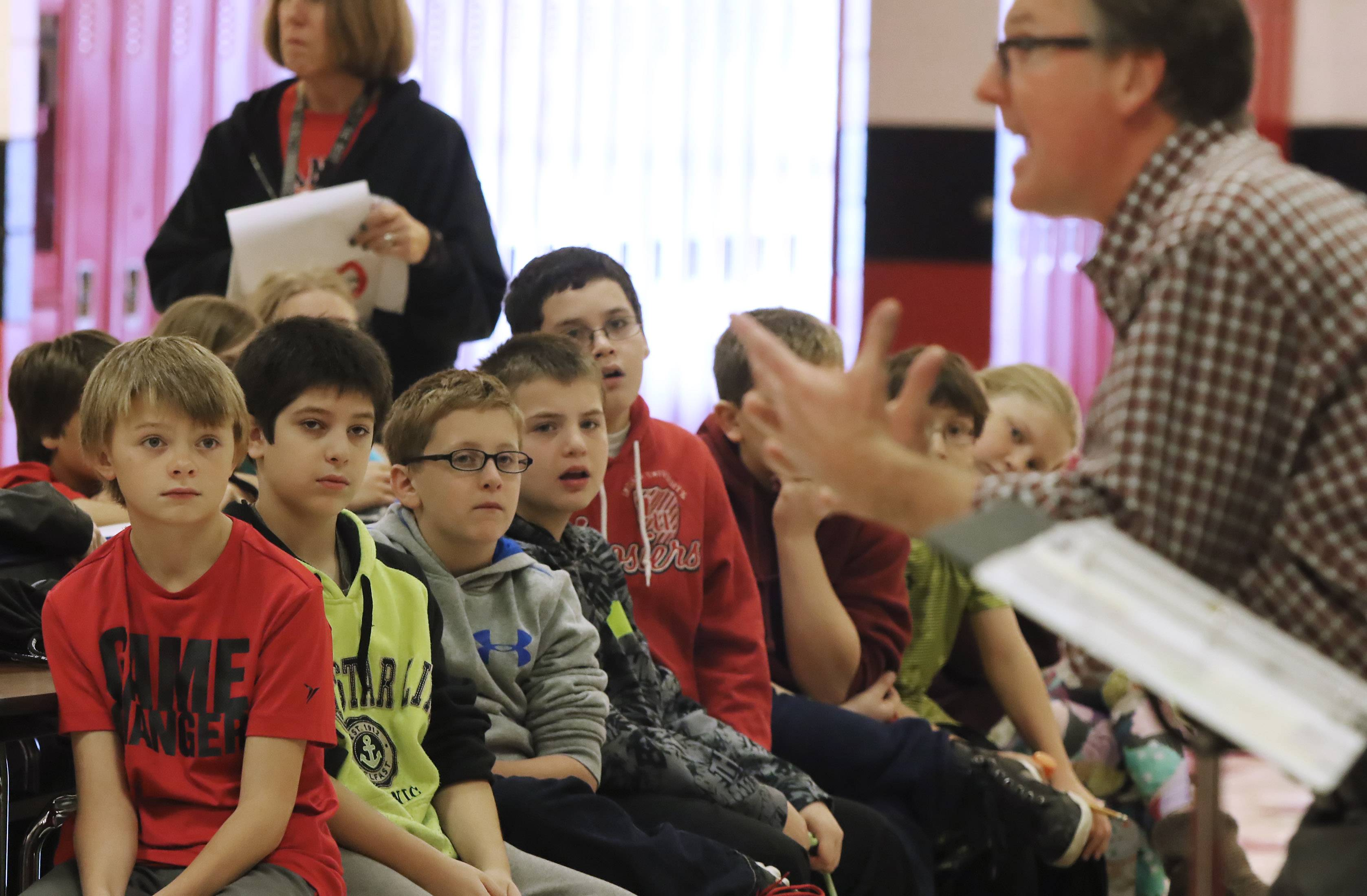 Middle school students listen to author Tim Shoemaker as he speaks about being a hero Tuesday at Stanton School in Fox Lake. Shoemaker writes mystery books intended for middle school students.
