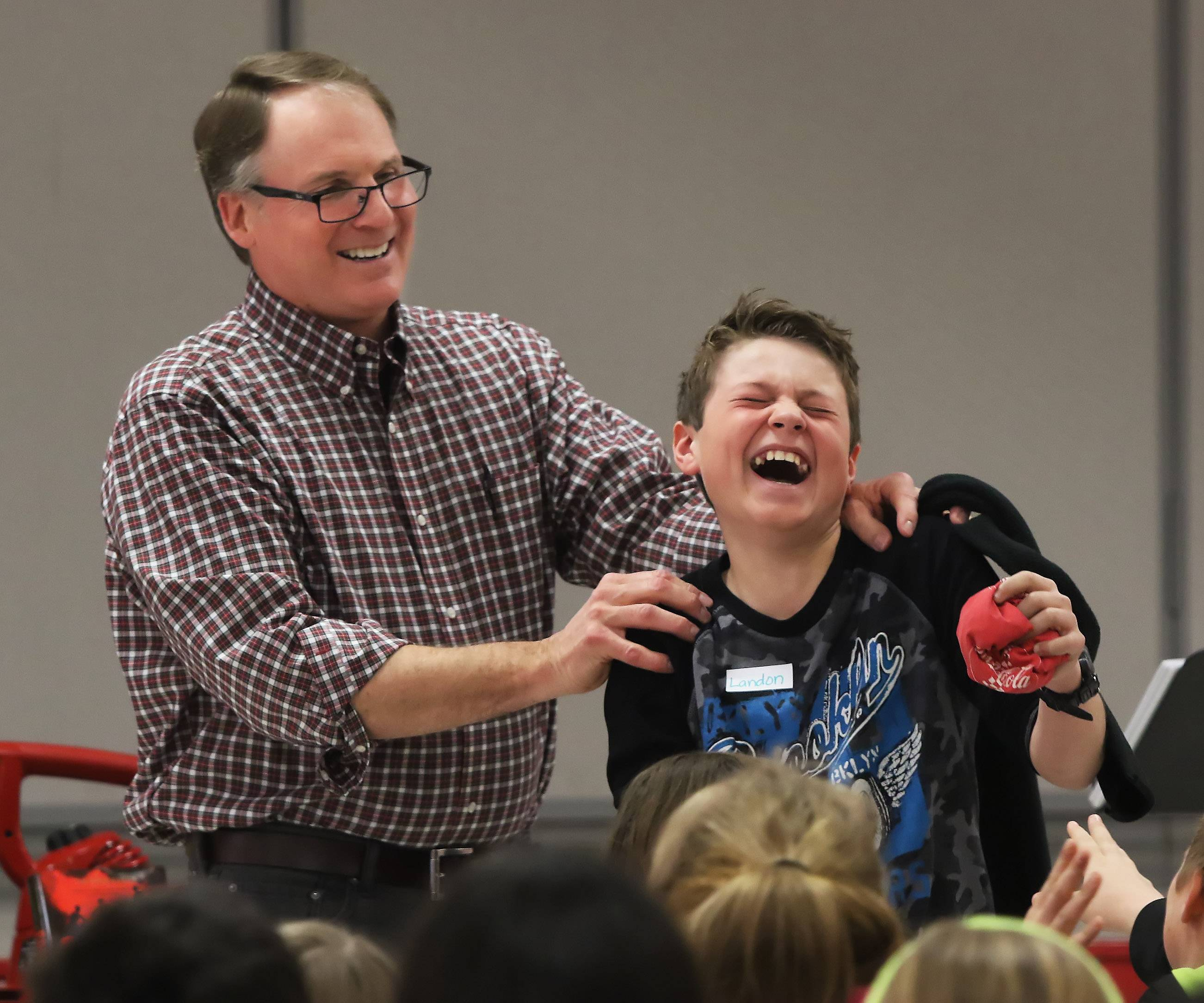 Fifth grader Landon Schultz laughs after participating in a demonstration with author Tim Shoemaker, who spoke with students Tuesday at Stanton School in Fox Lake. Shoemaker writes mystery books intended for middle school students.