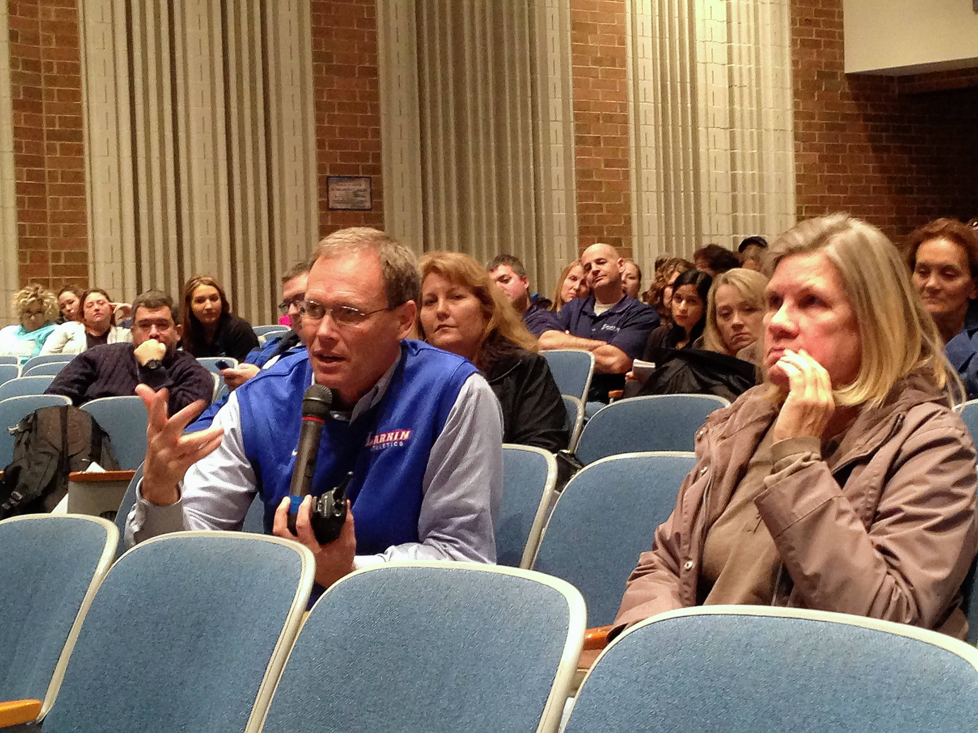 Larkin High School Principal Jon Tuin asks a panel of experts Wednesday about dealing with student stresses.