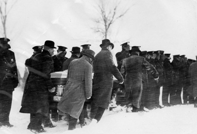 "FBI Special Agent Herman Hollis was buried in Des Moines, Iowa. Hollis and fellow agent Samuel P. Cowley were killed in the Battle of Barrington on Nov. 27, 1934, while trying to capture Lester ""Baby Face Nelson"" Gillis."