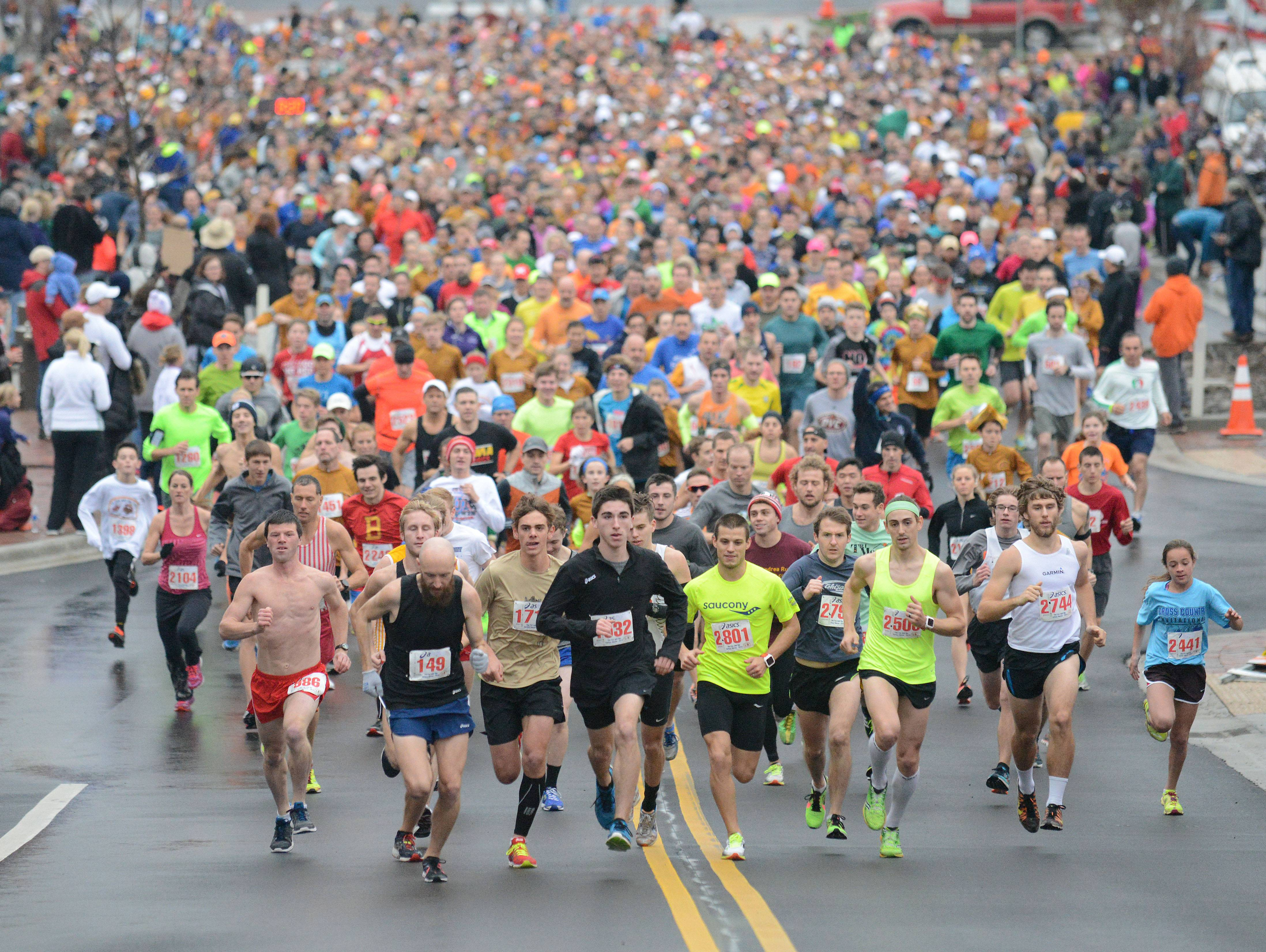 Runners take off west on Houston Street in the 4K The Fox & The Turkey Races Thanksgiving morning in downtown Batavia. The 2,820 runners were the most in 19 years, said Tom Spadafora, president of the host Fox River Trail Runners.