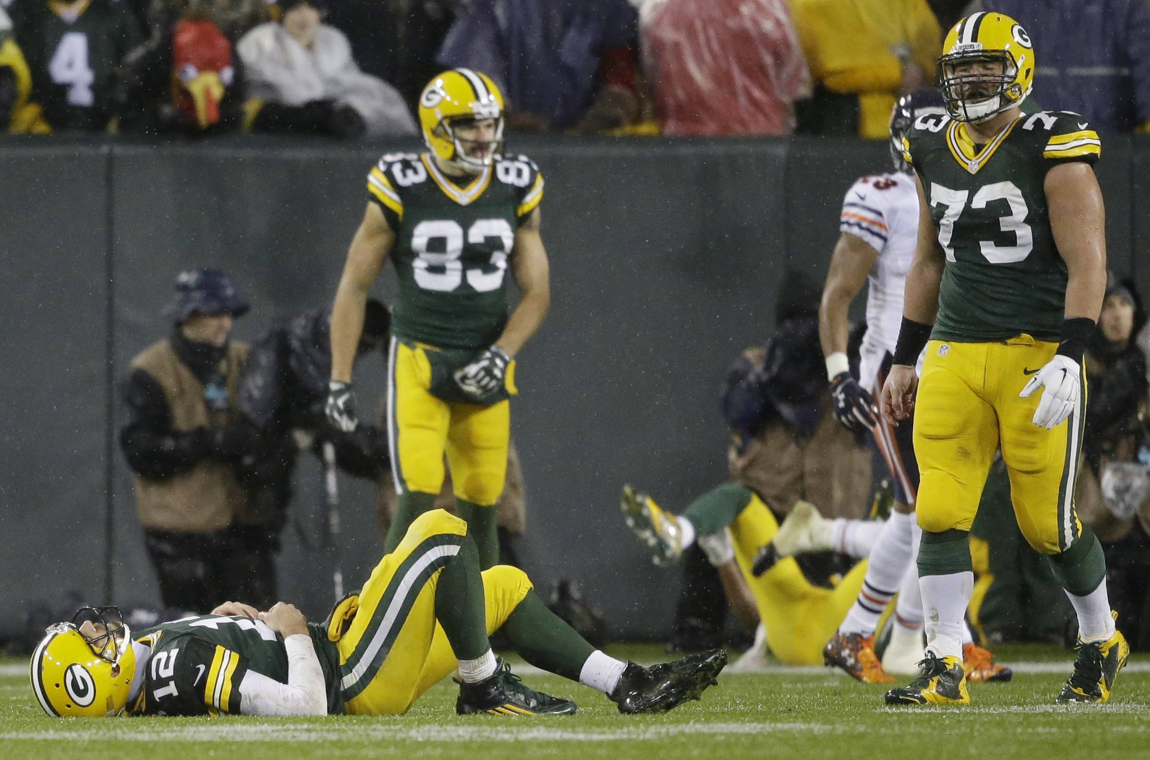 Green Bay Packers quarterback Aaron Rodgers lays on the field after failing to complete on fourth down in the final seconds against the Bears on Thursday night.