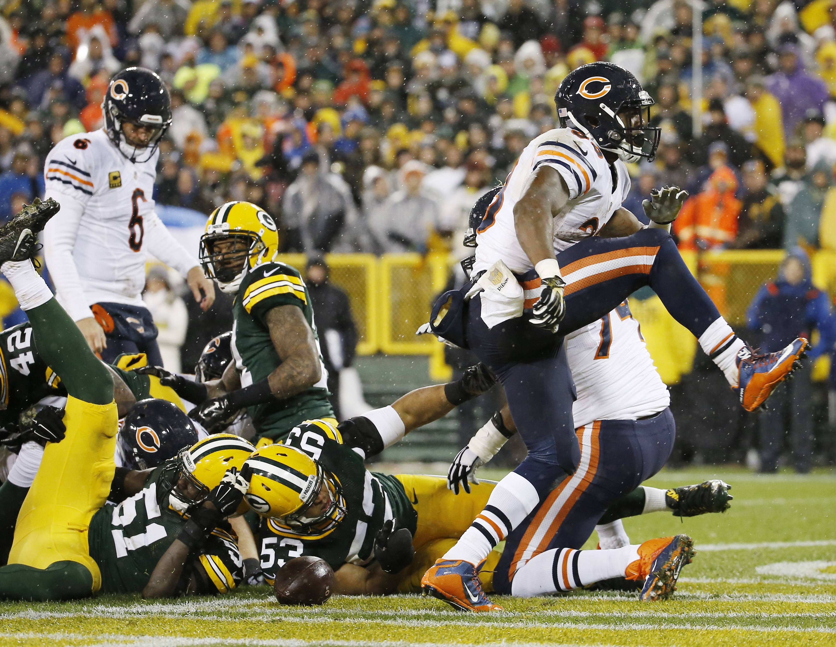 Chicago Bears' Jeremy Langford celebrates his touchdown run during the first half of an NFL football game against the Green Bay Packers Thursday, Nov. 26, 2015, in Green Bay, Wis.