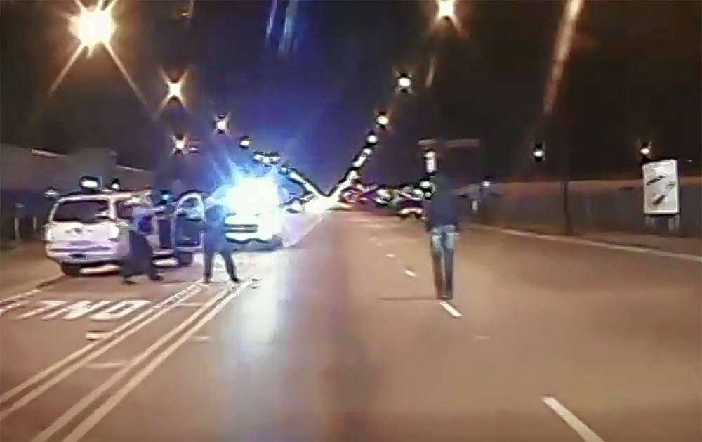 This frame from dash-cam video released Tuesday by the Chicago Police Department shows Chicago police officer Jason Van Dyke about to shoot 17-year-old Laquan McDonald.