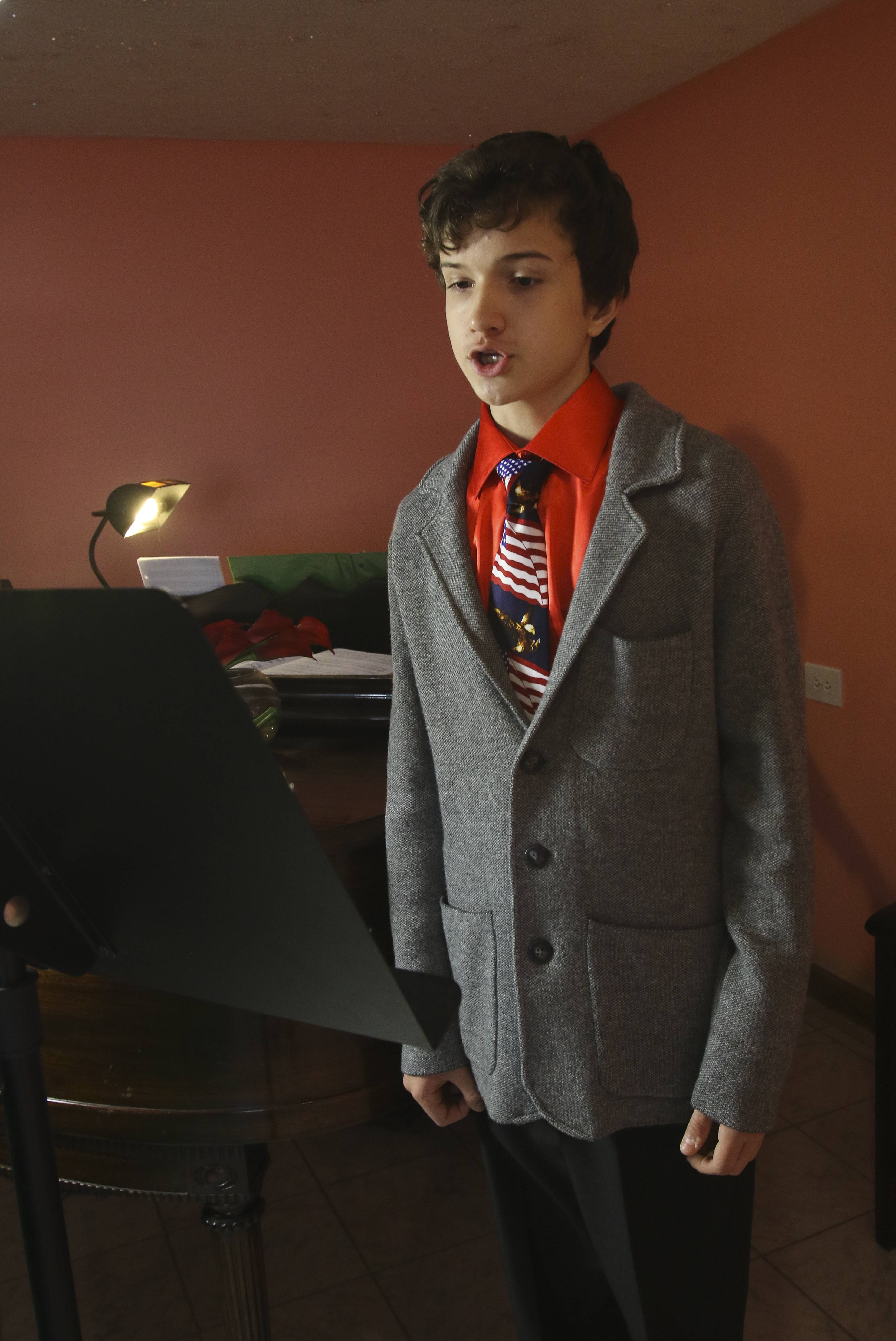 Sheridan Archbold, 14, practices singing opera every day at his home in Yorkville. He hopes to become a professional opera singer, but admits his talents may also be suited to classical crossover.