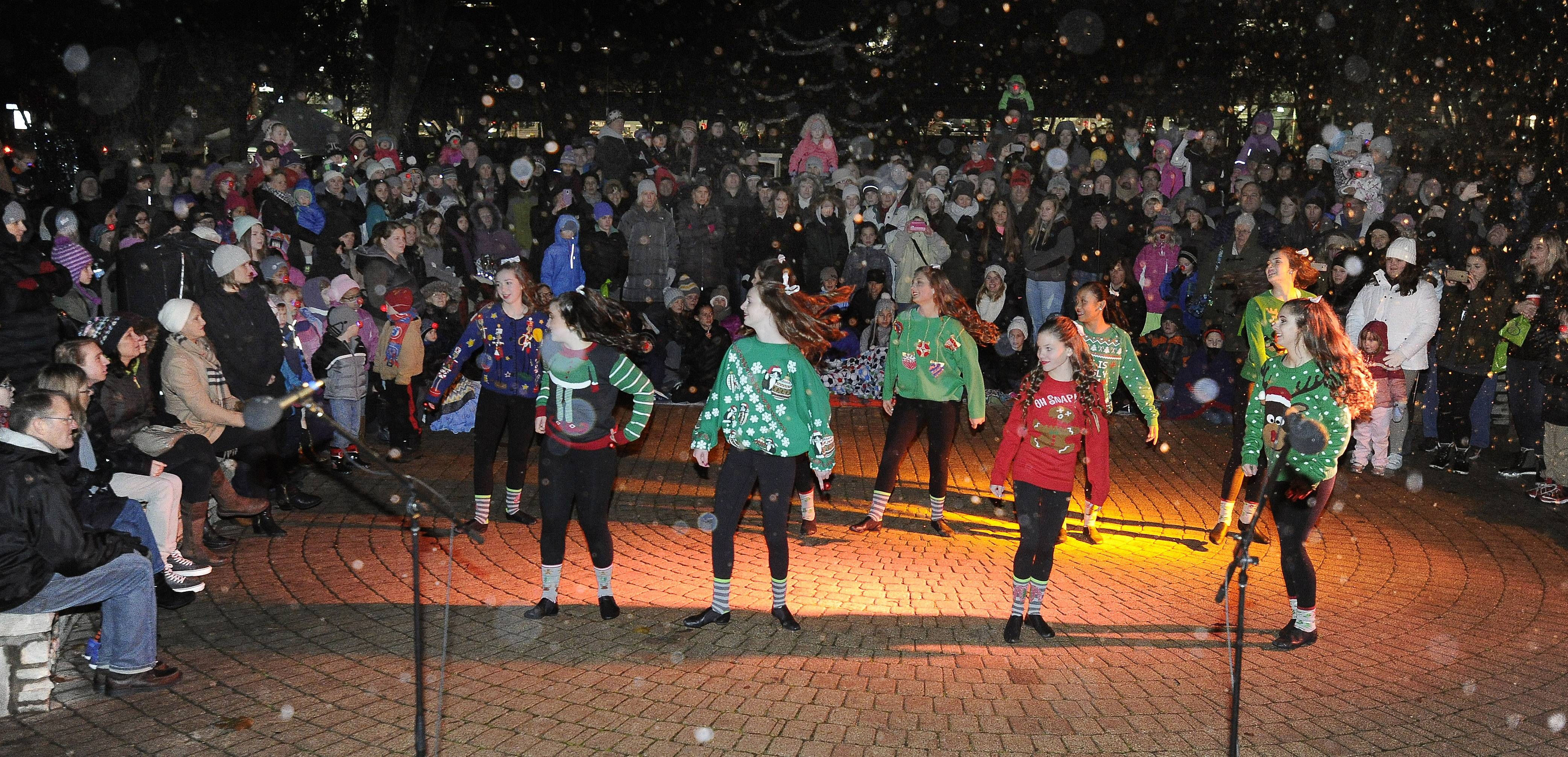 The Vibe Dance Company of the Arlington Heights Park District entertains the gallery of people who came out Friday to enjoy the Arlington Heights annual tree-lighting festival in North School Park.