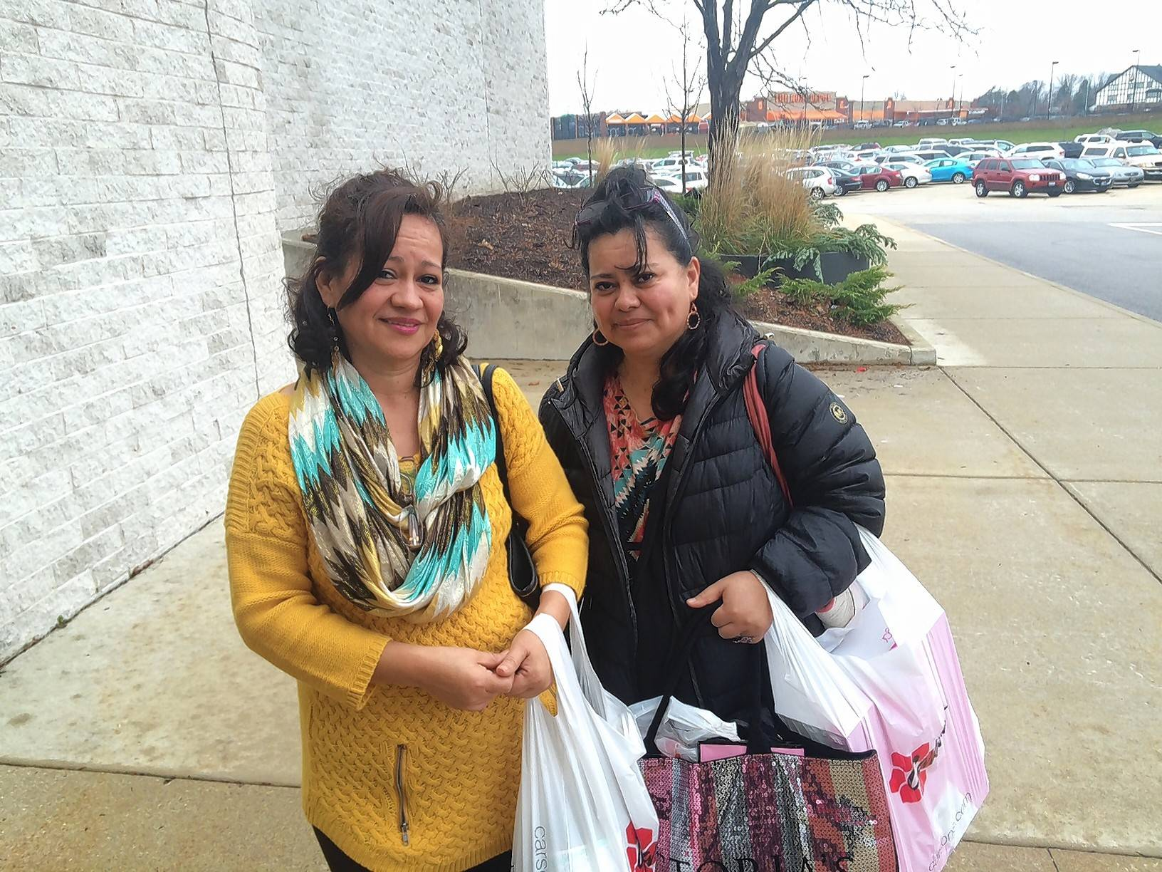 Imelda Zuniga of Algonquin, left, and her sister Cecilia Barbosa, of Detroit, Michigan, shopped Friday at Carson Pirie Scott in West Dundee.