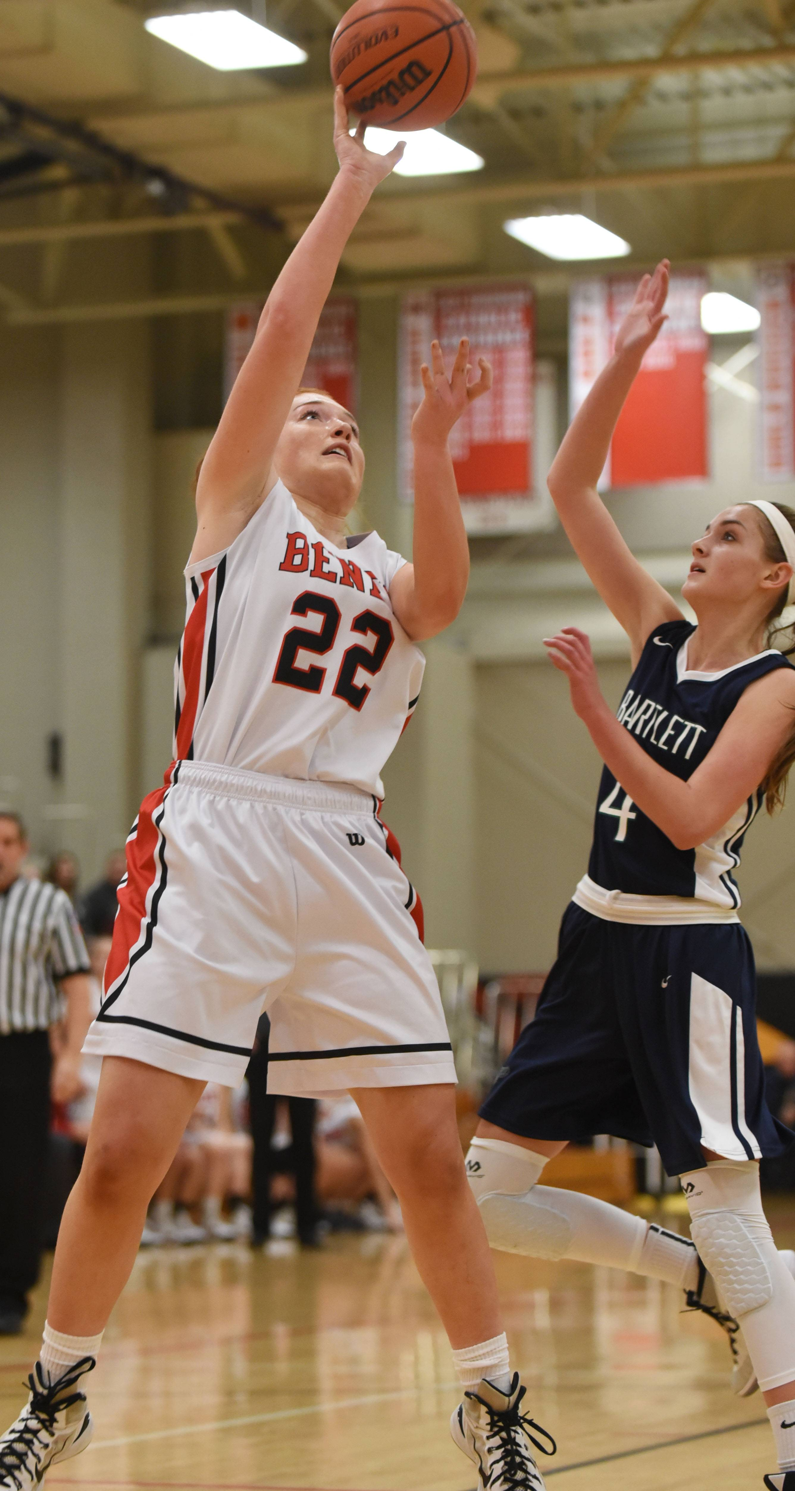 Kendal Schramek of Benet takes a shot while Kayla Hare of Bartlett attempts to block during the Bartlett at Benet girls basketball game Friday in Lisle.