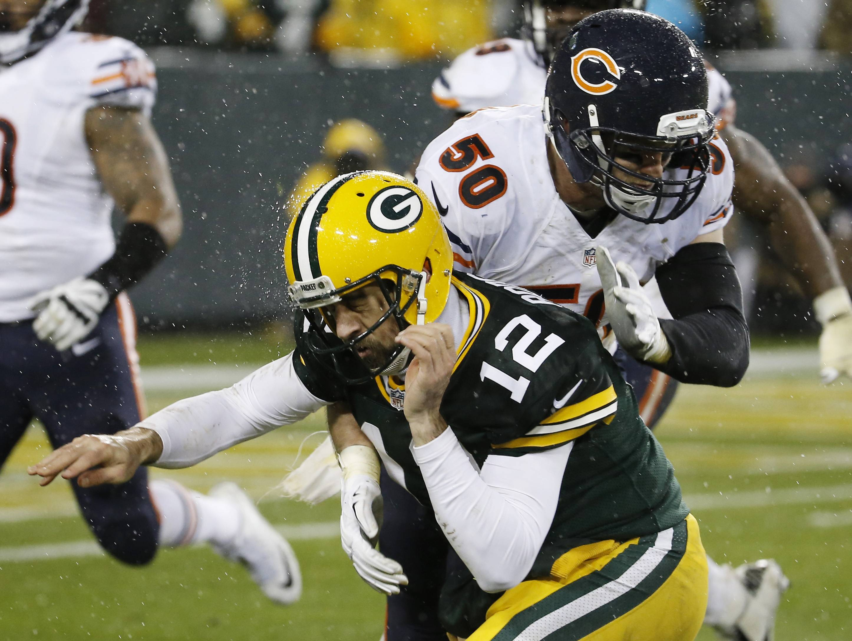 Green Bay Packers' Aaron Rodgers is hit by Bears' Shea McClellin after throwing a pass on Thursday in Green Bay, Wis.
