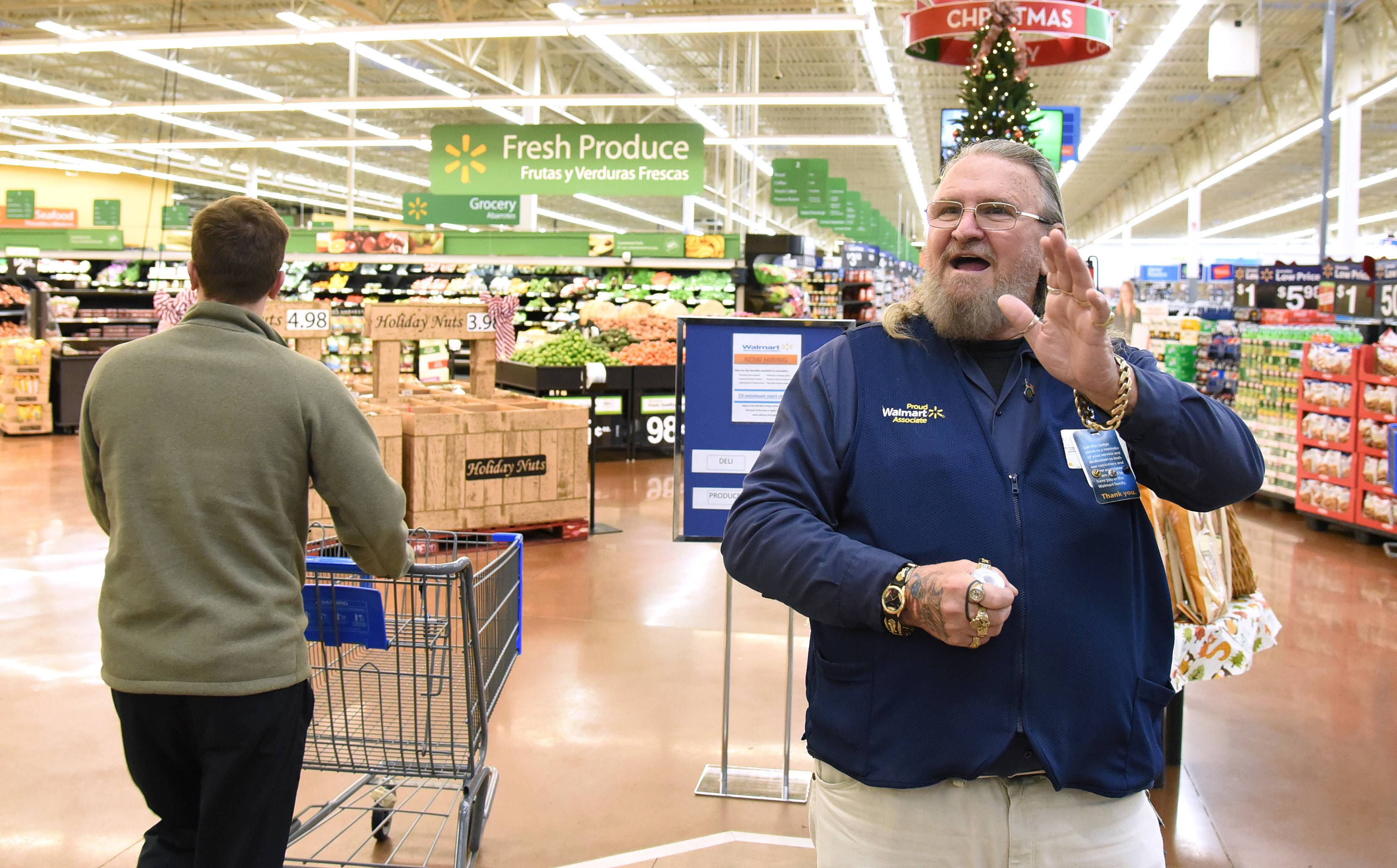Wal-Mart greeter George Cornwell of Aurora says hello to every person who walks in  sc 1 st  Daily Herald & Meet the tattoo-covered greeter who charms Wal-Mart shoppers