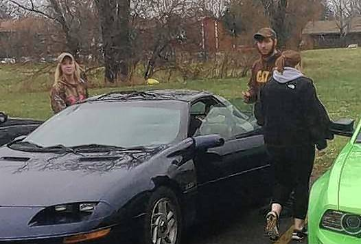 A friend shot this photo of Promise Williamsen, left, James Seward and Kelly Cronin, back to the camera, with Williamsen's 1994 Chevrolet Camaro Friday afternoon shortly before the single-car crash that killed the three 18-year-olds.