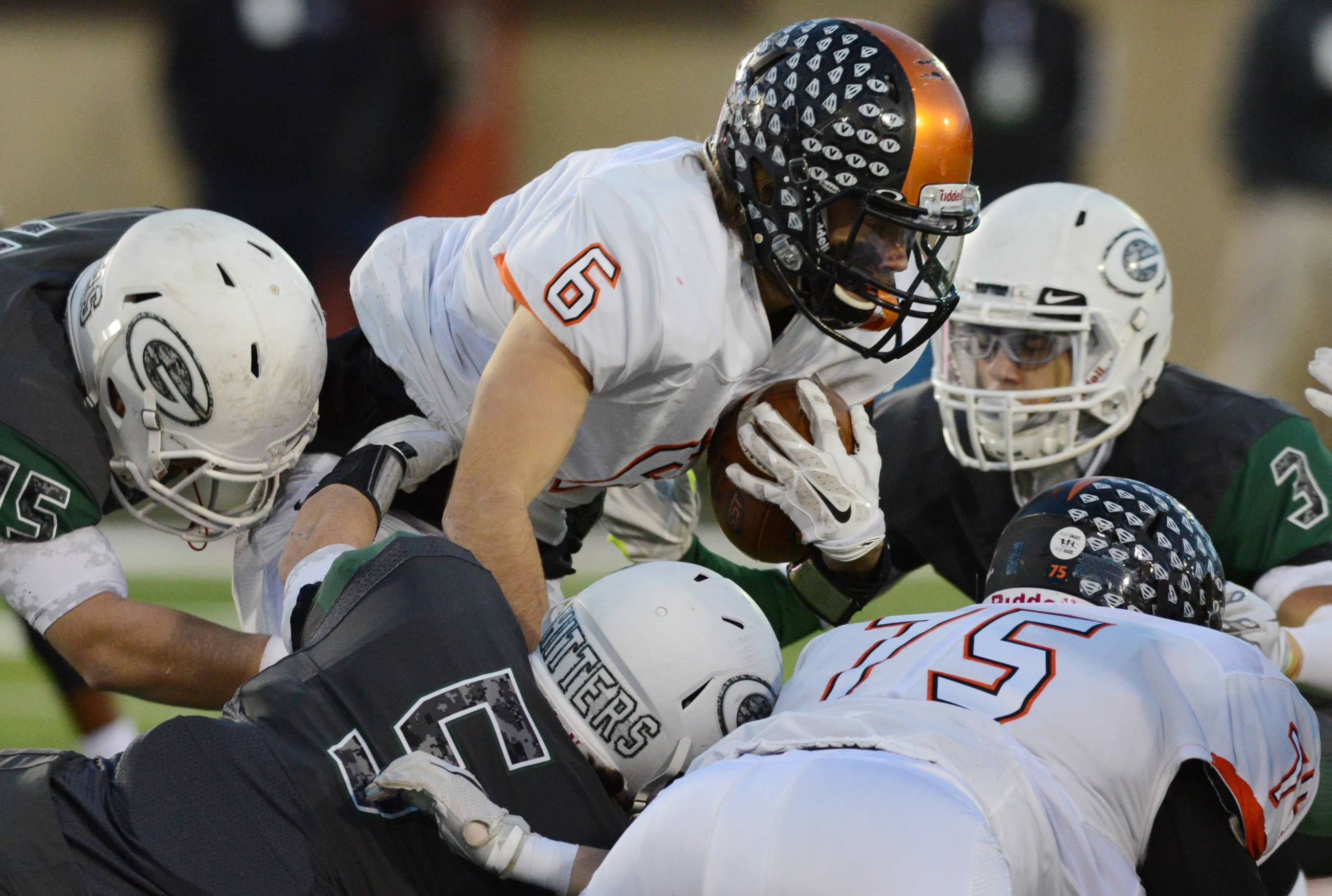 Libertyville quarterback Riley Lees carries the ball against Glenbard West in the Class 7A football state championship game on Saturday at Huskie Stadium in DeKalb.
