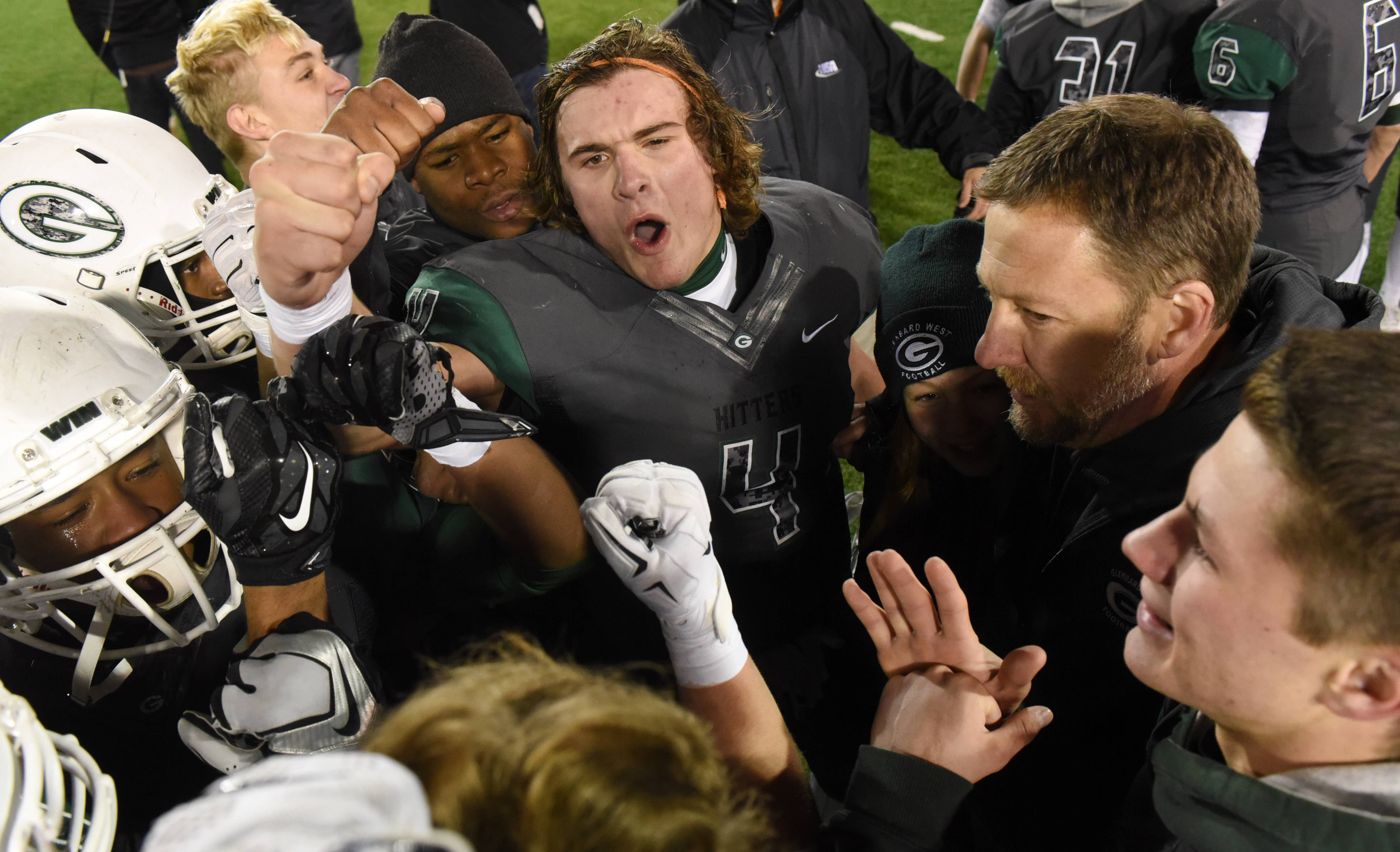 Glenbard West's Sam Brodner, top, celebrates with his teammates after defeating Libertyville in the Class 7A football championship game at Northern Illinois University in DeKalb Saturday.