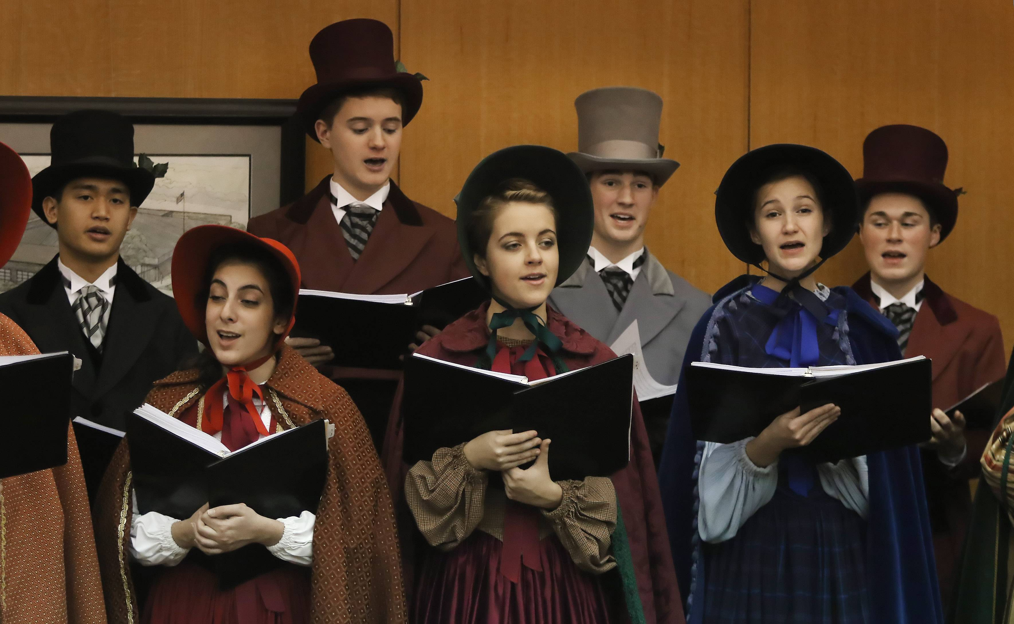 The John Hersey High School Charles Dickens Carolers sang holiday tunes while dressed in Victorian-era garb Sunday at Prospect Heights Public Library.