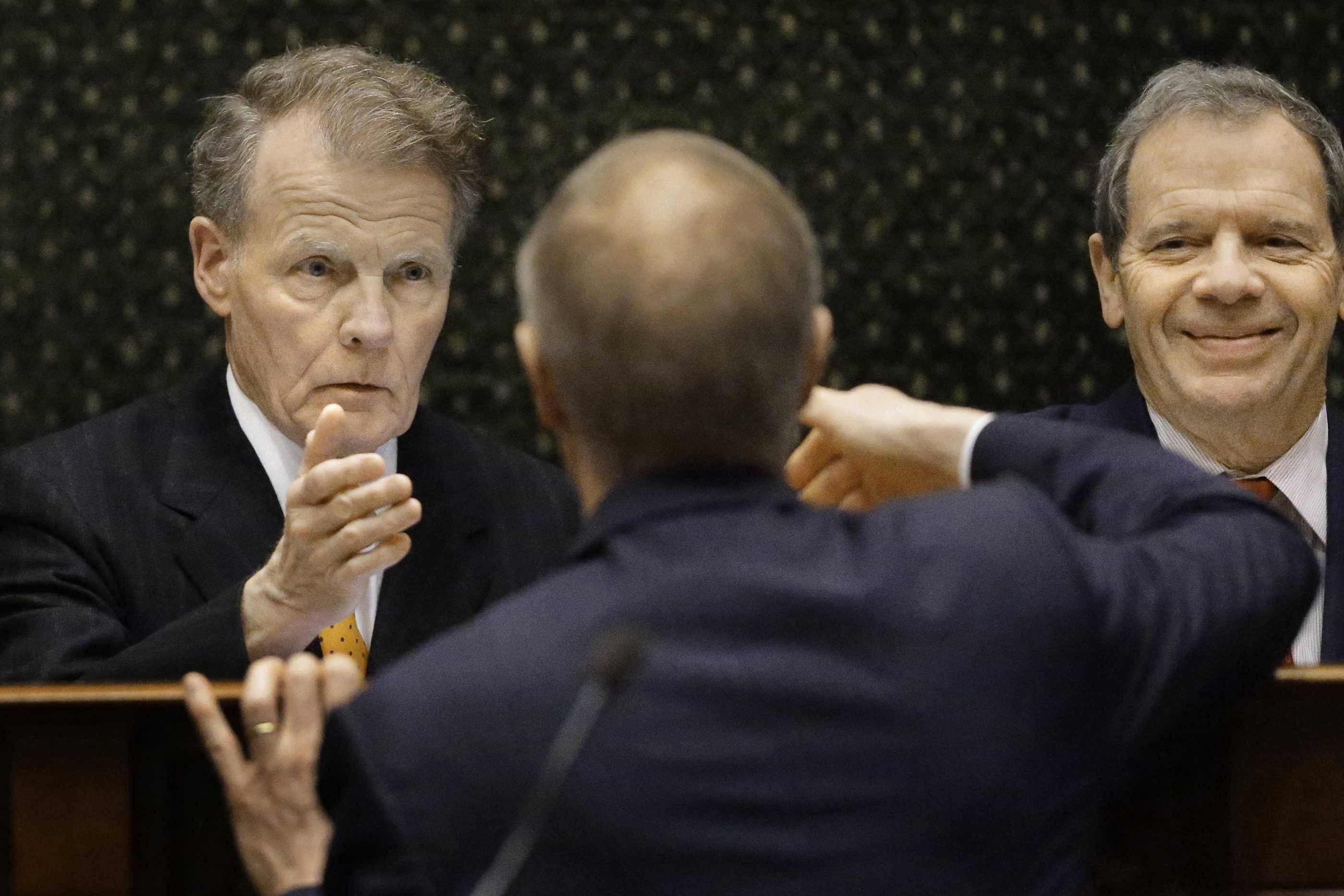 Gov. Bruce Rauner, center, reaches to shake the hand of House Speaker Michael Madigan last February after delivering the State of the State address. The two, plus other top legislative Republicans and Democrats, are set to meet Tuesday.