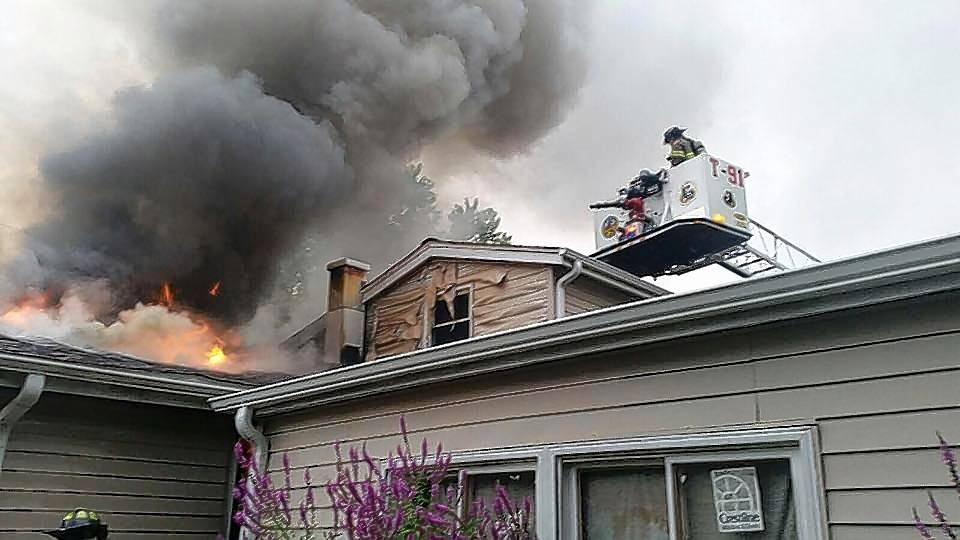 Firefighters battle the August fire that destroyed the Catalan family's Carpentersville house.