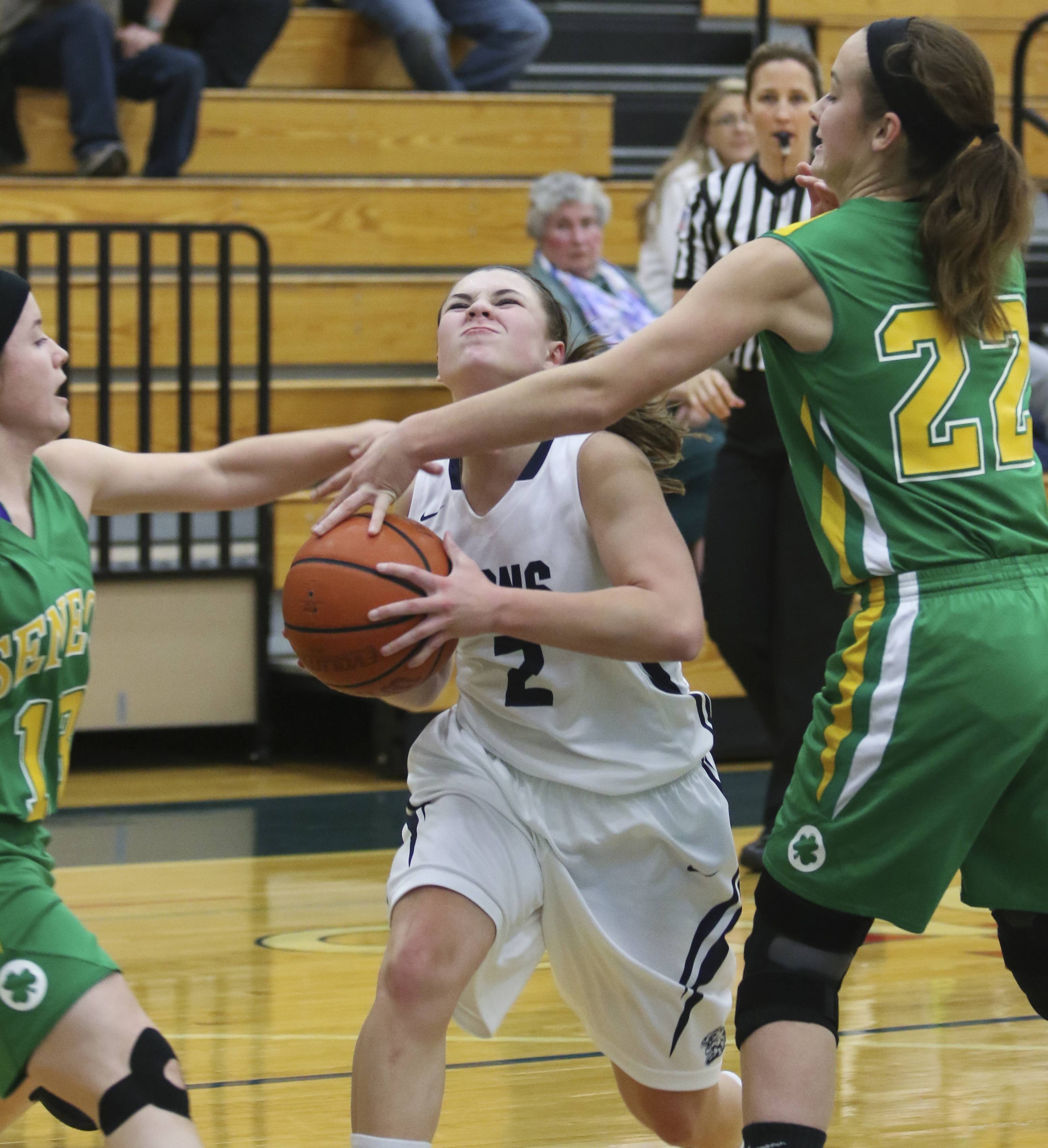Lisle's Natalie Takahashi is fouled as she makes her way to the basket in action against Seneca during girls basketball on Monday in Lisle.