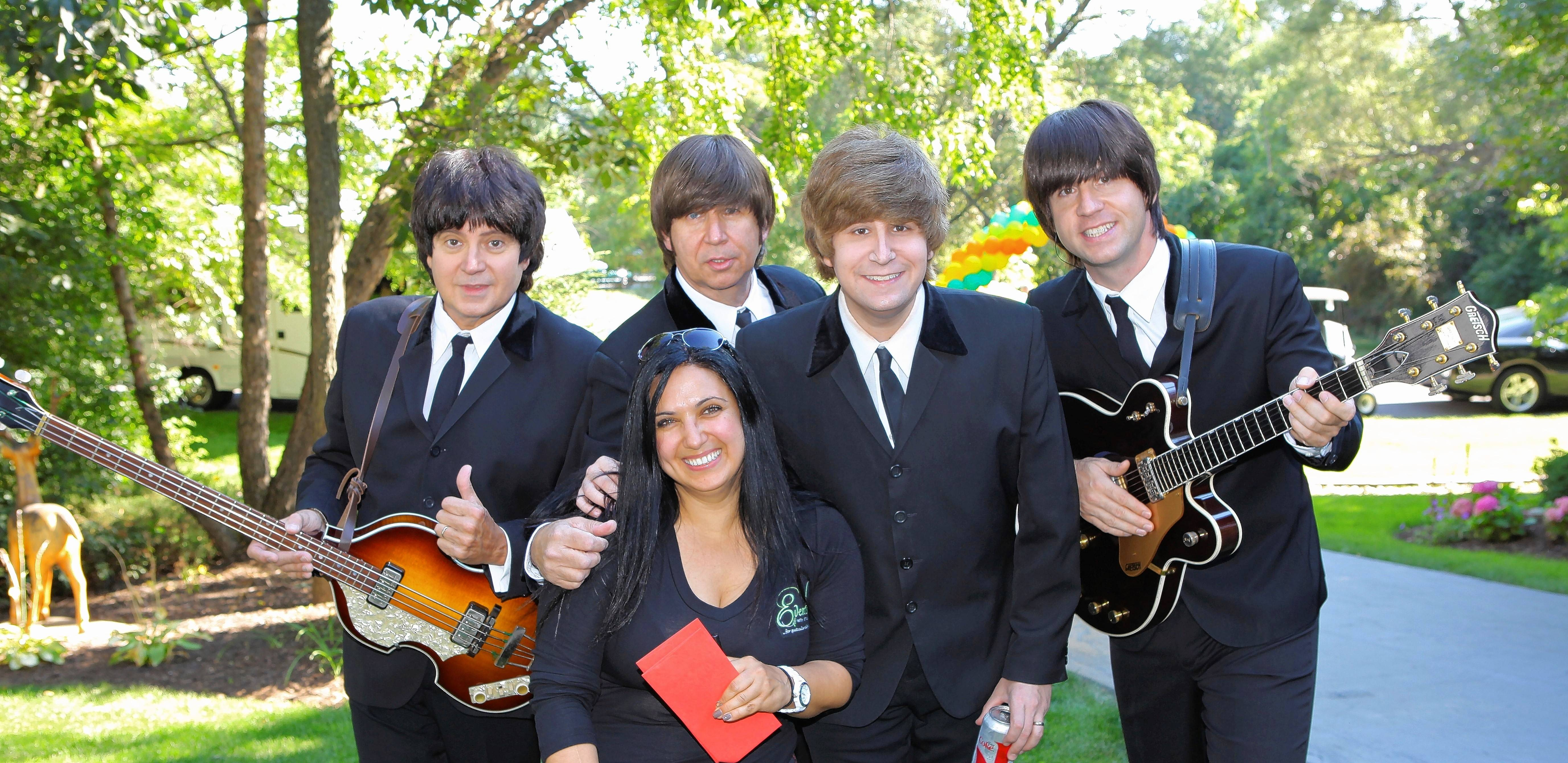 Hanan Hafez, center, poses with the band, American English, during a 2013 event with 135 people in Deer Park.