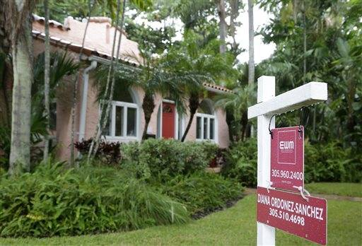 FILE - This Wednesday, Oct. 7, 2015, file photo, shows a home for sale in Coral Gables, Fla. The National Association of Realtors releases, on Monday, Nov. 30, 2015, its October report on pending home sales, which are seen as a barometer of future purchases. (AP Photo/Lynne Sladky, File)
