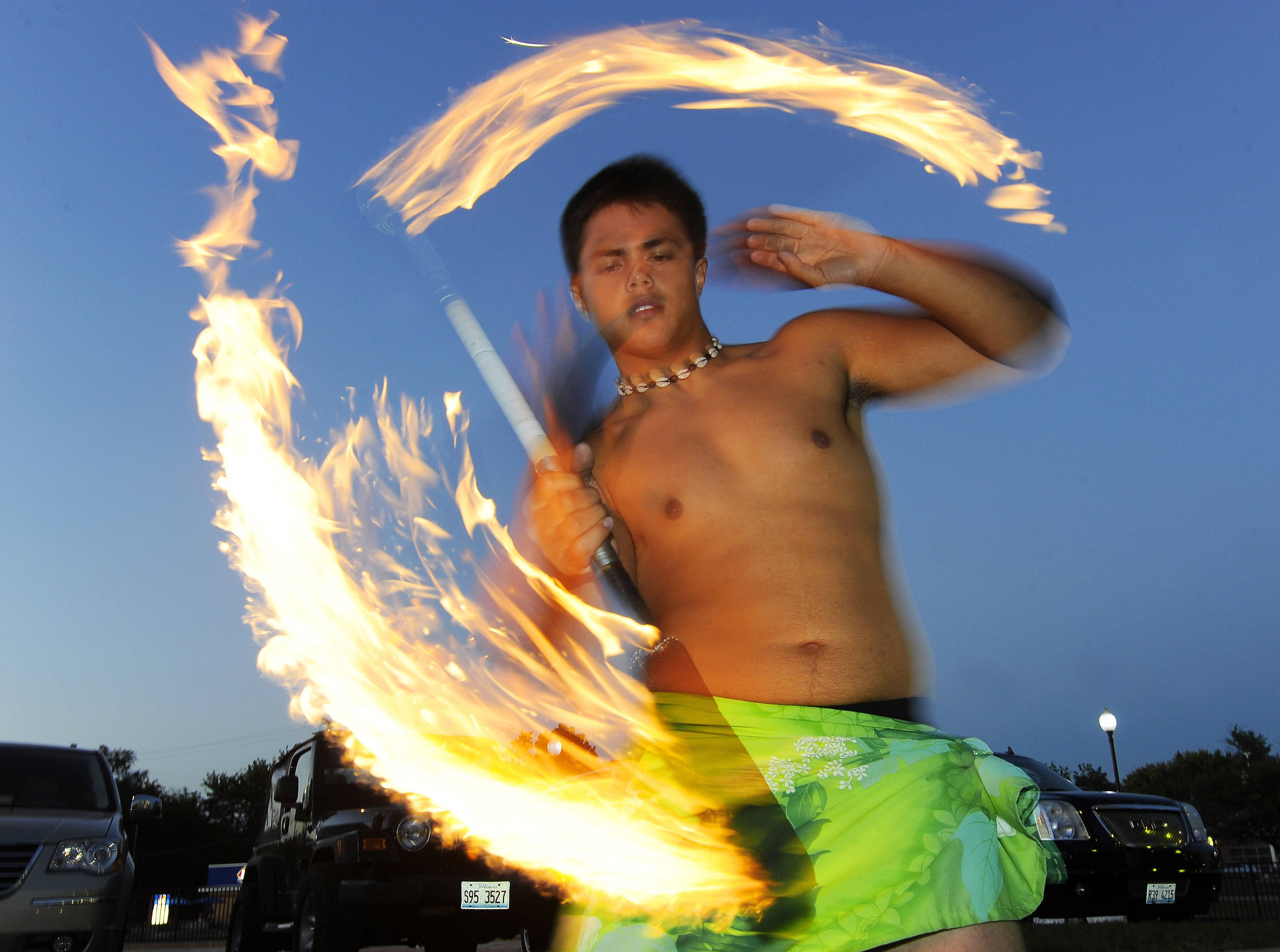 Meet the Maine West football player who moonlights as fire dancer
