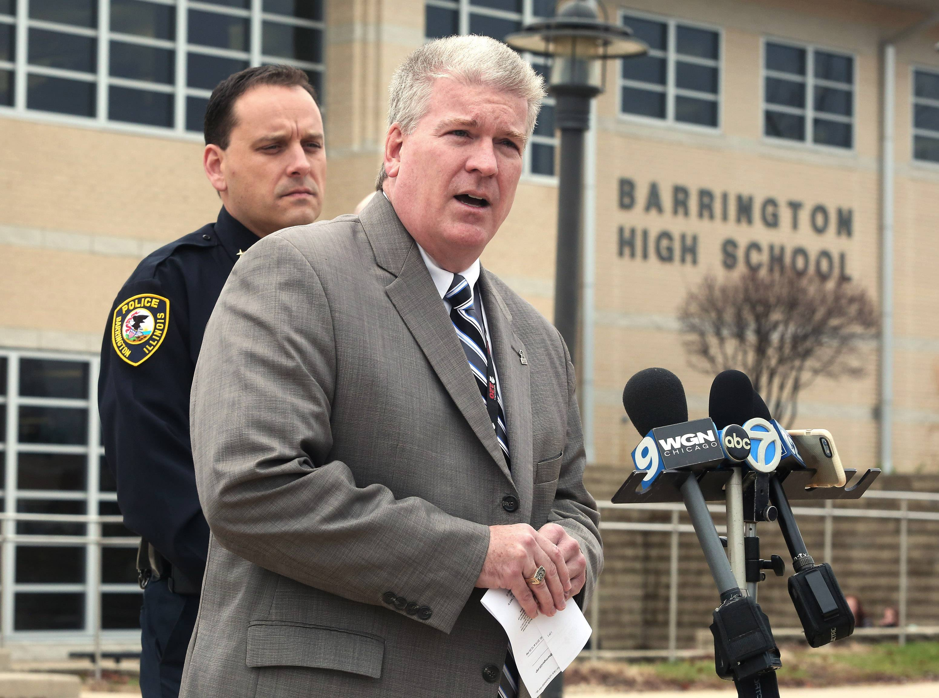 Barrington District 220 Superintendent Brian Harris, wearing gray, and Barrington Police Chief Dave Dorn discuss the arrest of 16-year-old Barrington High School student in possession of a handgun and drugs Monday morning. The campus was locked down for about 45 minutes after a school employee spotted the weapon.