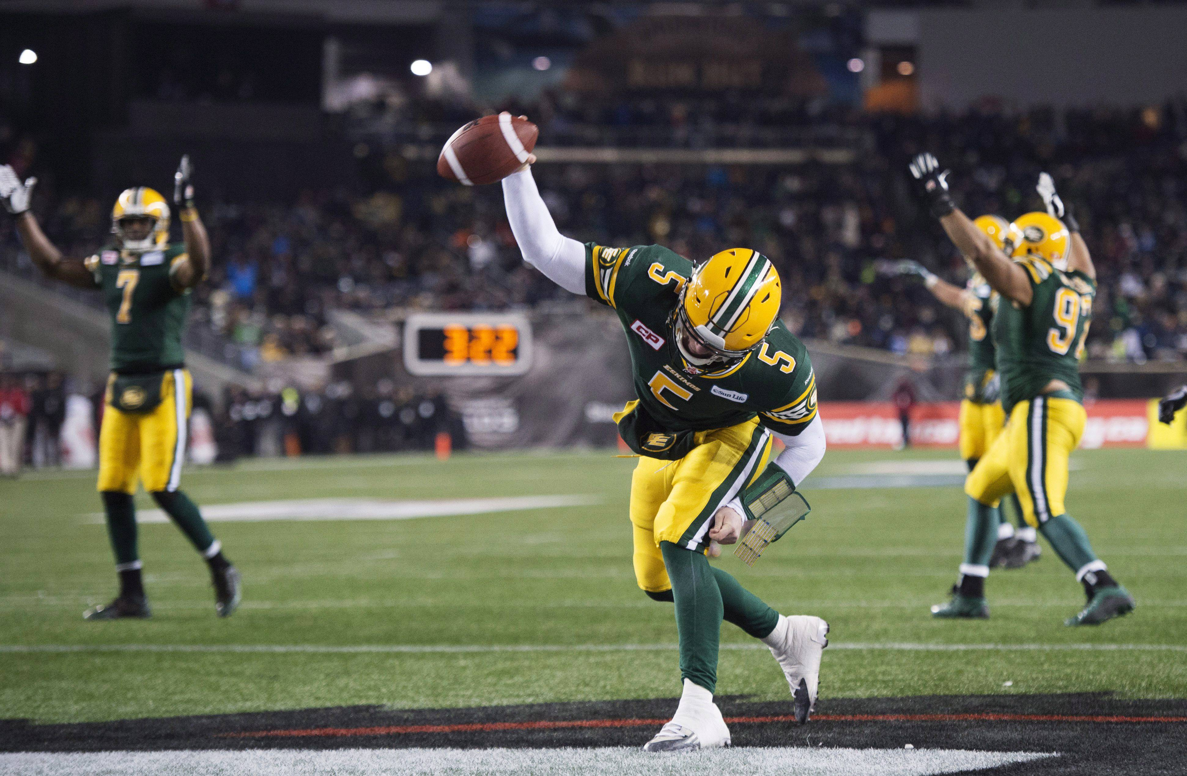 Edmonton Eskimos' quarterback Jordan Lynch scores the game-winning touchdown Sunday during the second half of the 103rd Grey Cup football game against the Ottawa Redblacks in Winnipeg, Manitoba.