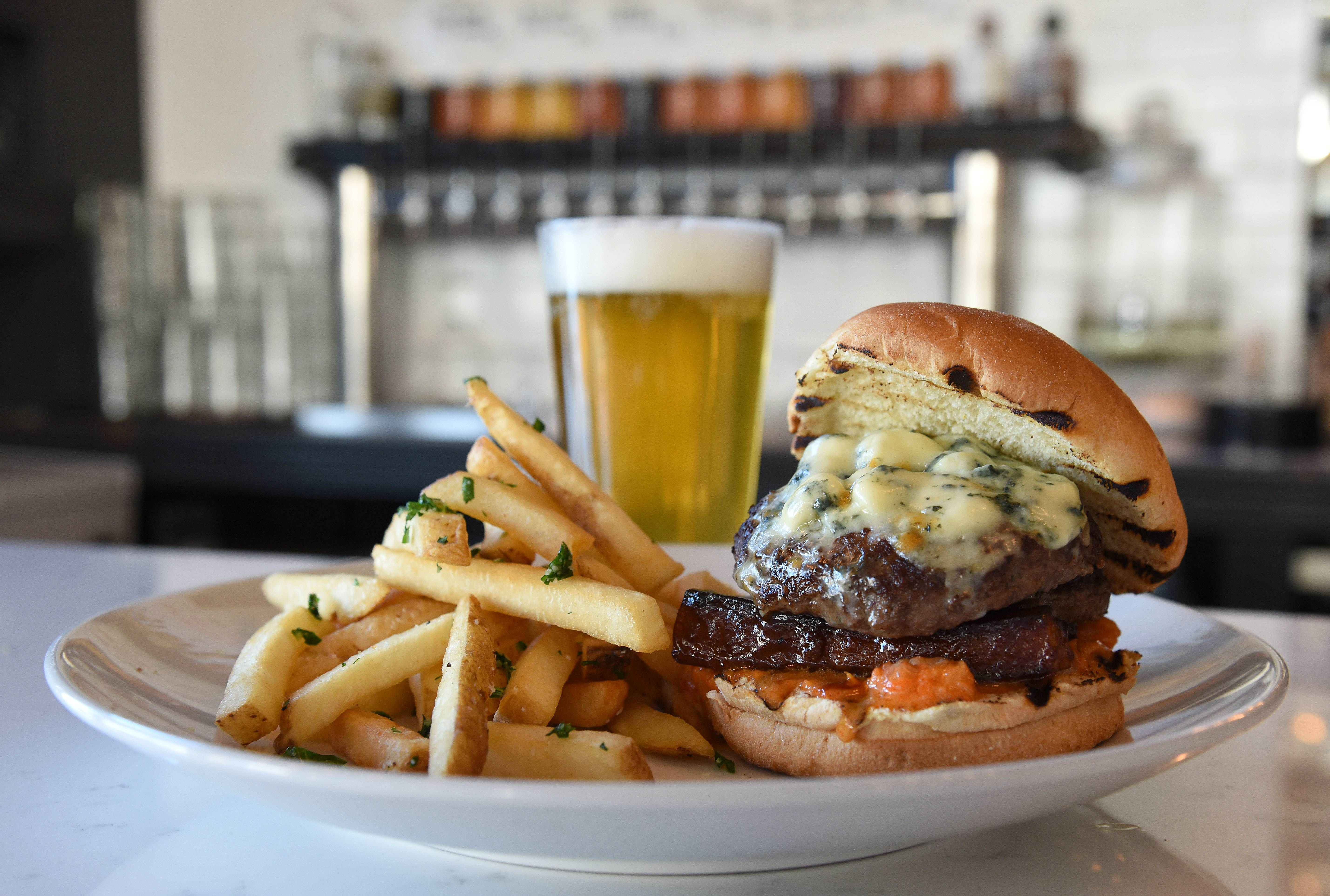 Hungry? The Finery's burger of the month looks to satisfy. Order it with a craft beer like the 5 Rabbit Super Pils.
