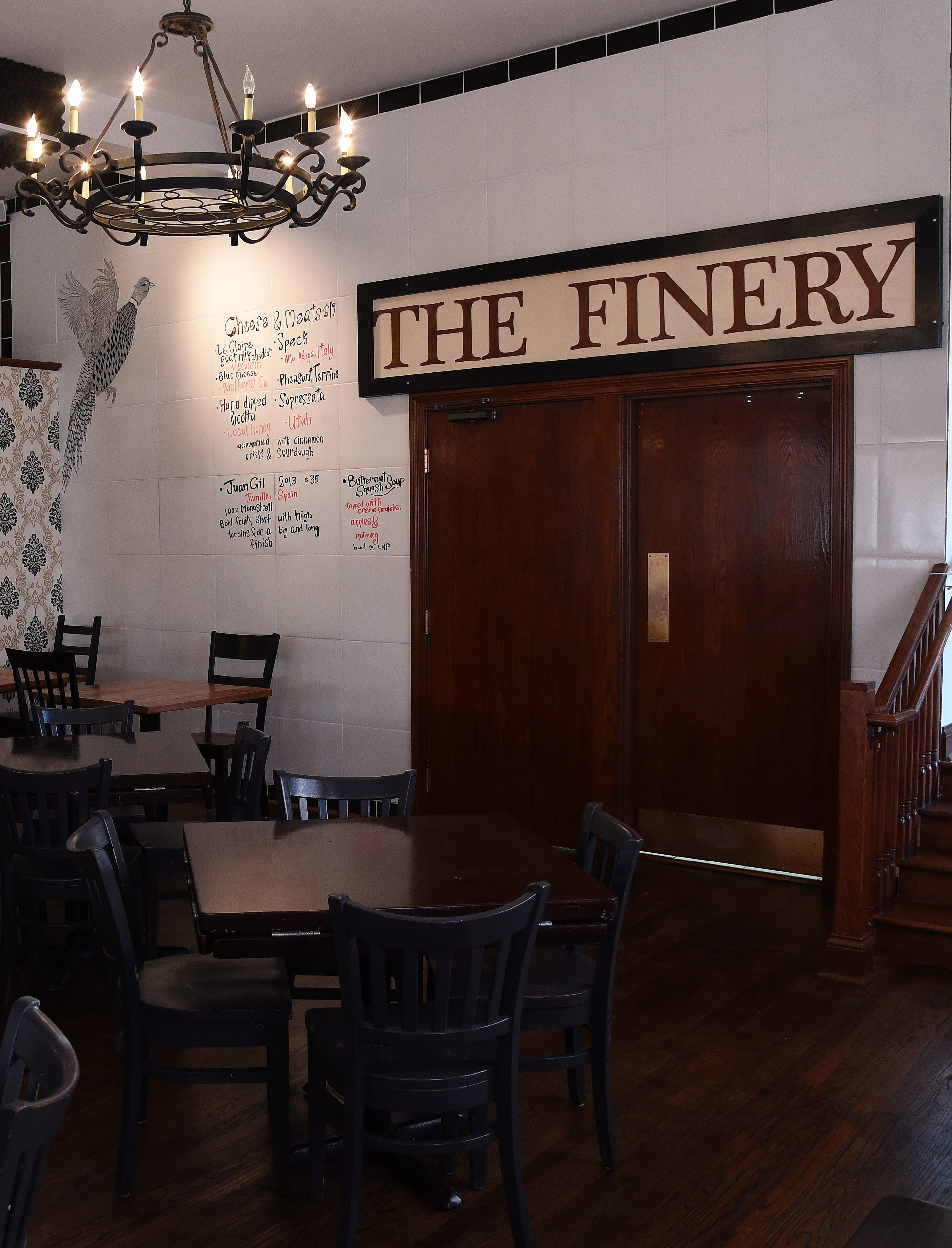 Menu specials are written on the tile walls at The Finery in St. Charles.