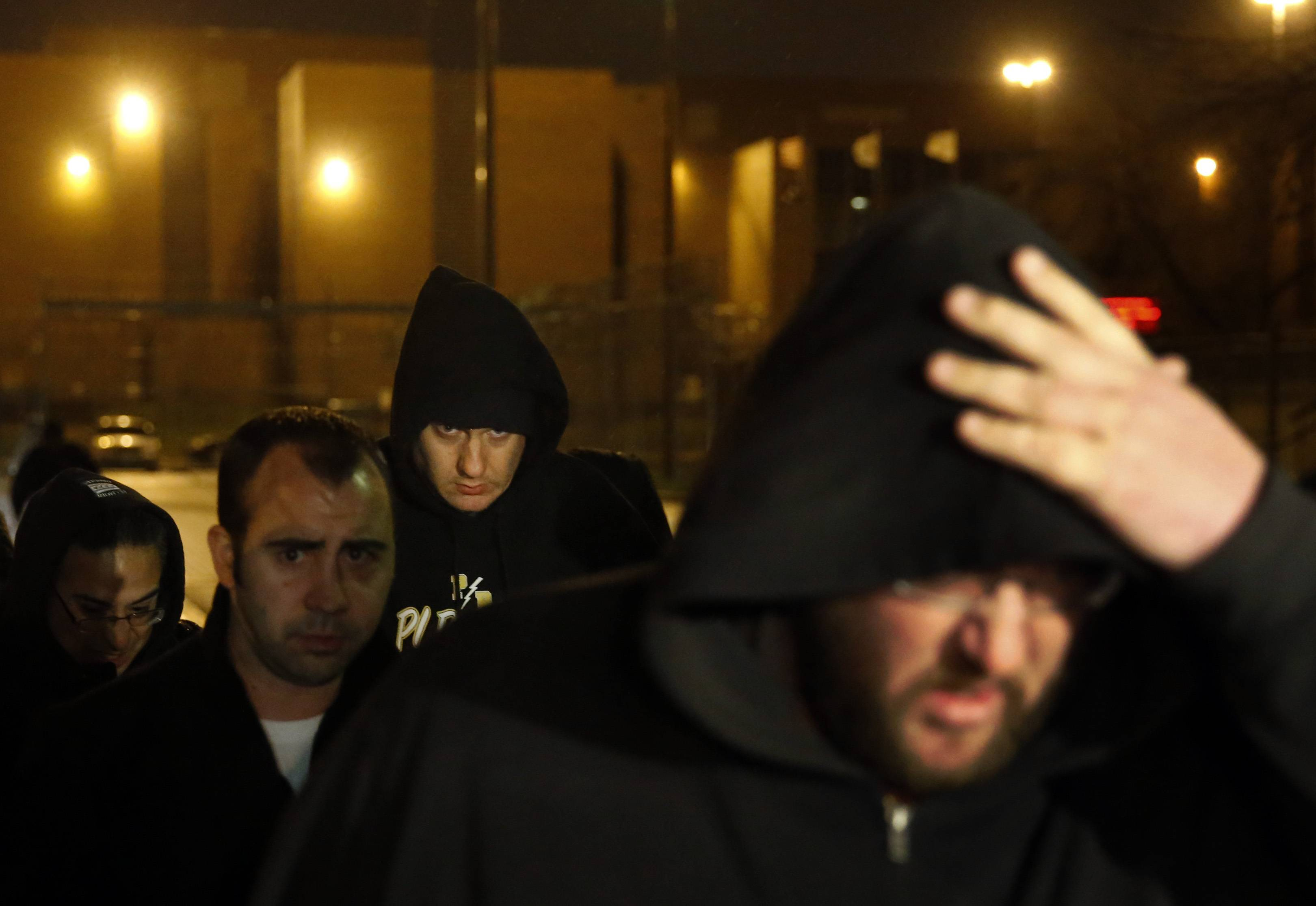 Chicago Police Officer Jason Van Dyke, back middle, leaves the Cook County Jail after posting bond on Monday, Nov. 30, 2015, in Chicago. Van Dyke has been locked up since Nov. 24, when prosecutors charged him with first-degree murder in the shooting death of 17-year-old Laquan McDonald.