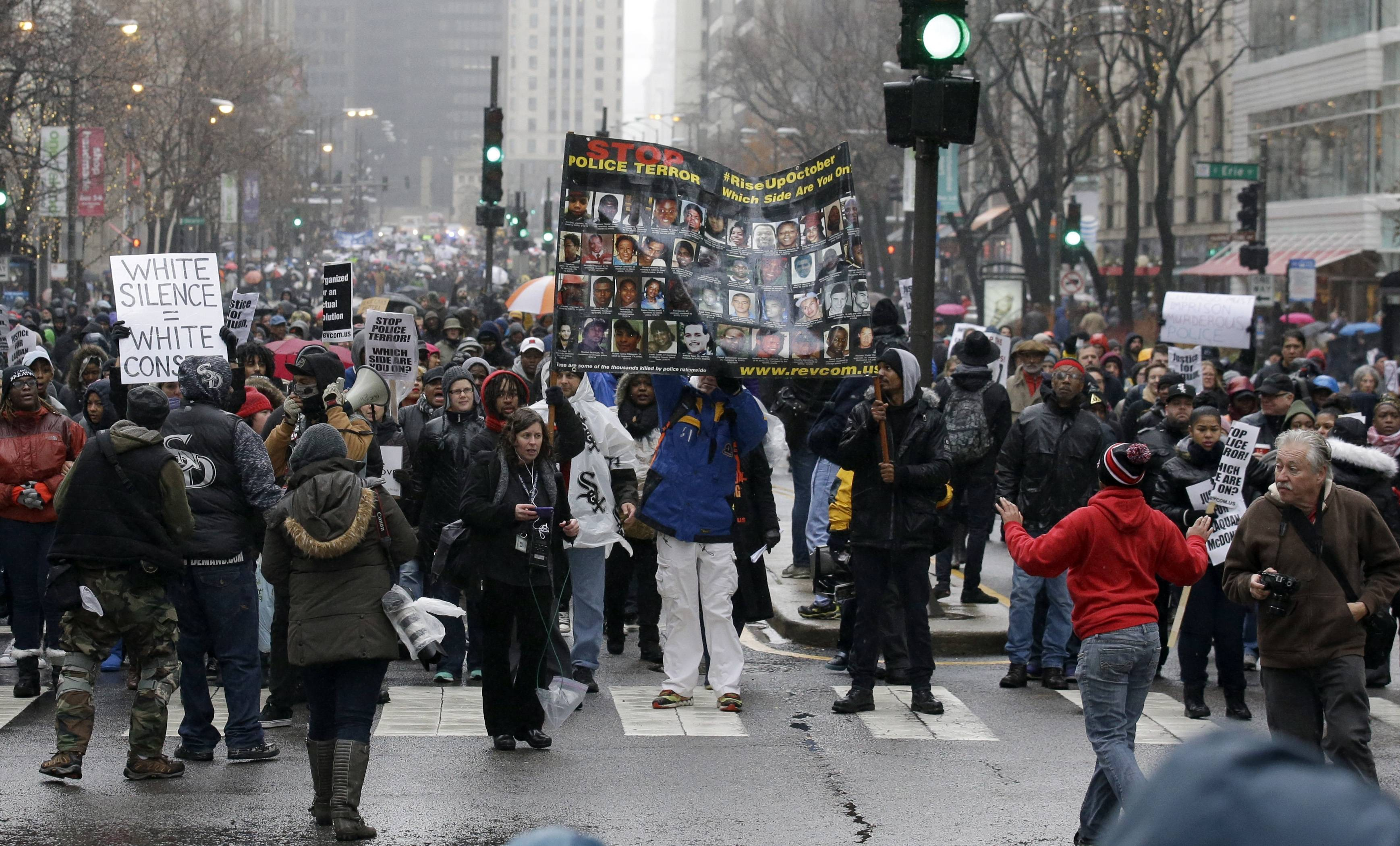 "Protesters make their way up North Michigan Avenue on Friday, Nov. 27, 2015, in Chicago as community activists and labor leaders hold a demonstration billed as a ""march for justice"" in the wake of the release of video showing an officer fatally shooting Laquan McDonald."