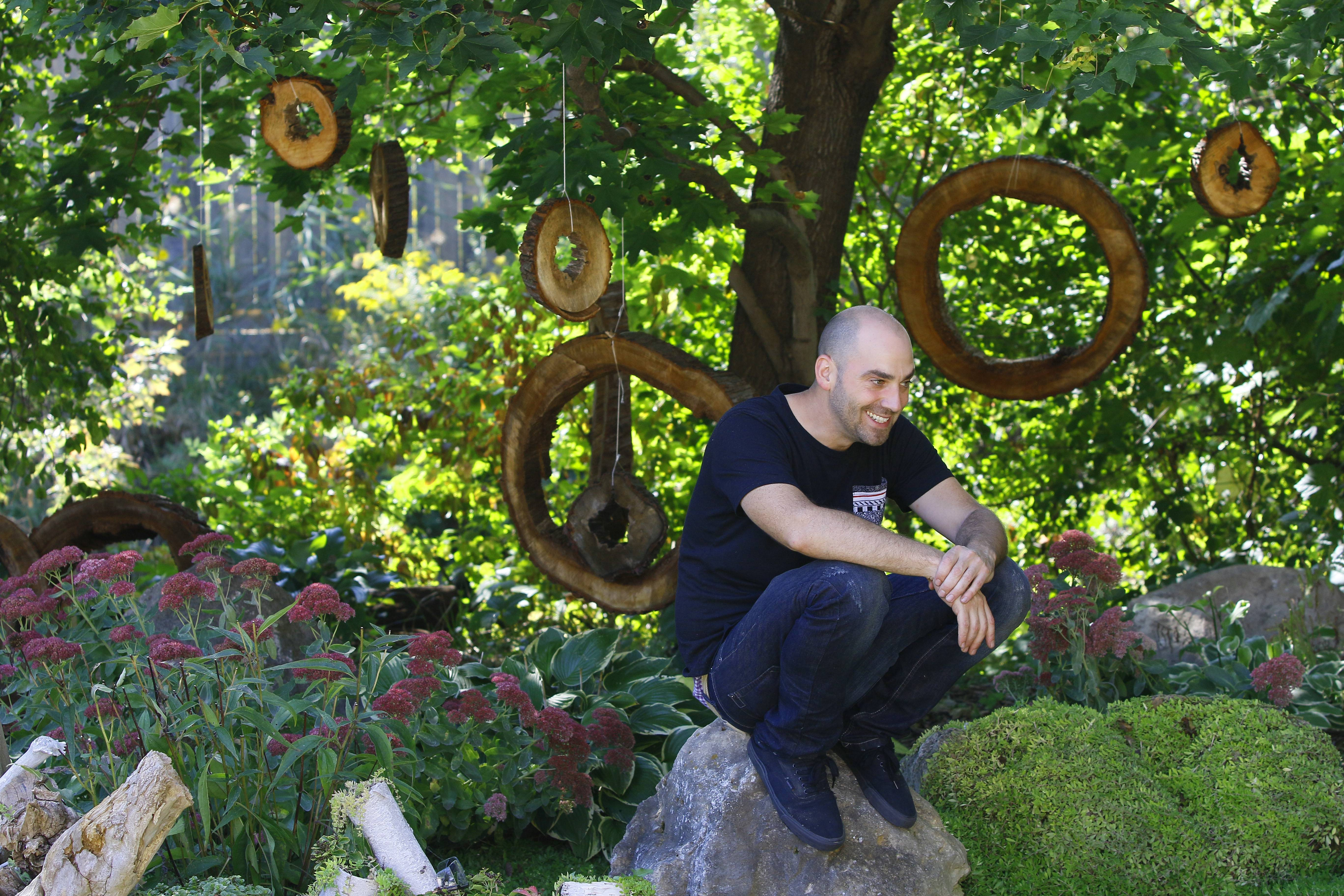 Paul Kuhn created hanging tree ring ornaments from a hollowed out tree on his Naperville property.