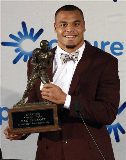 Mississippi State quarterback Dak Prescott holds the Conerly Trophy awarded  to Mississippi's top college football player