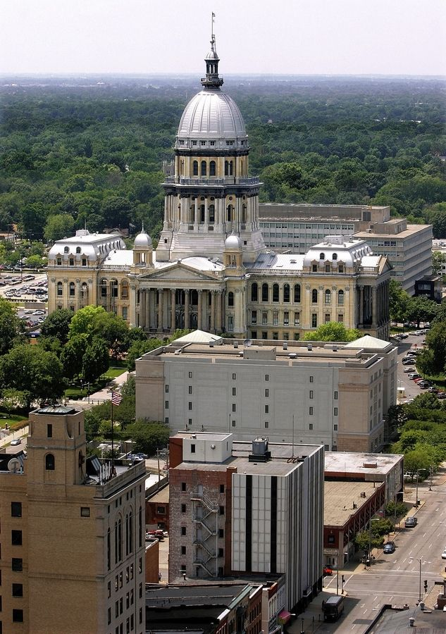 State lawmakers continued their budget debate Wednesday by trying to send some state money to suburban communities.