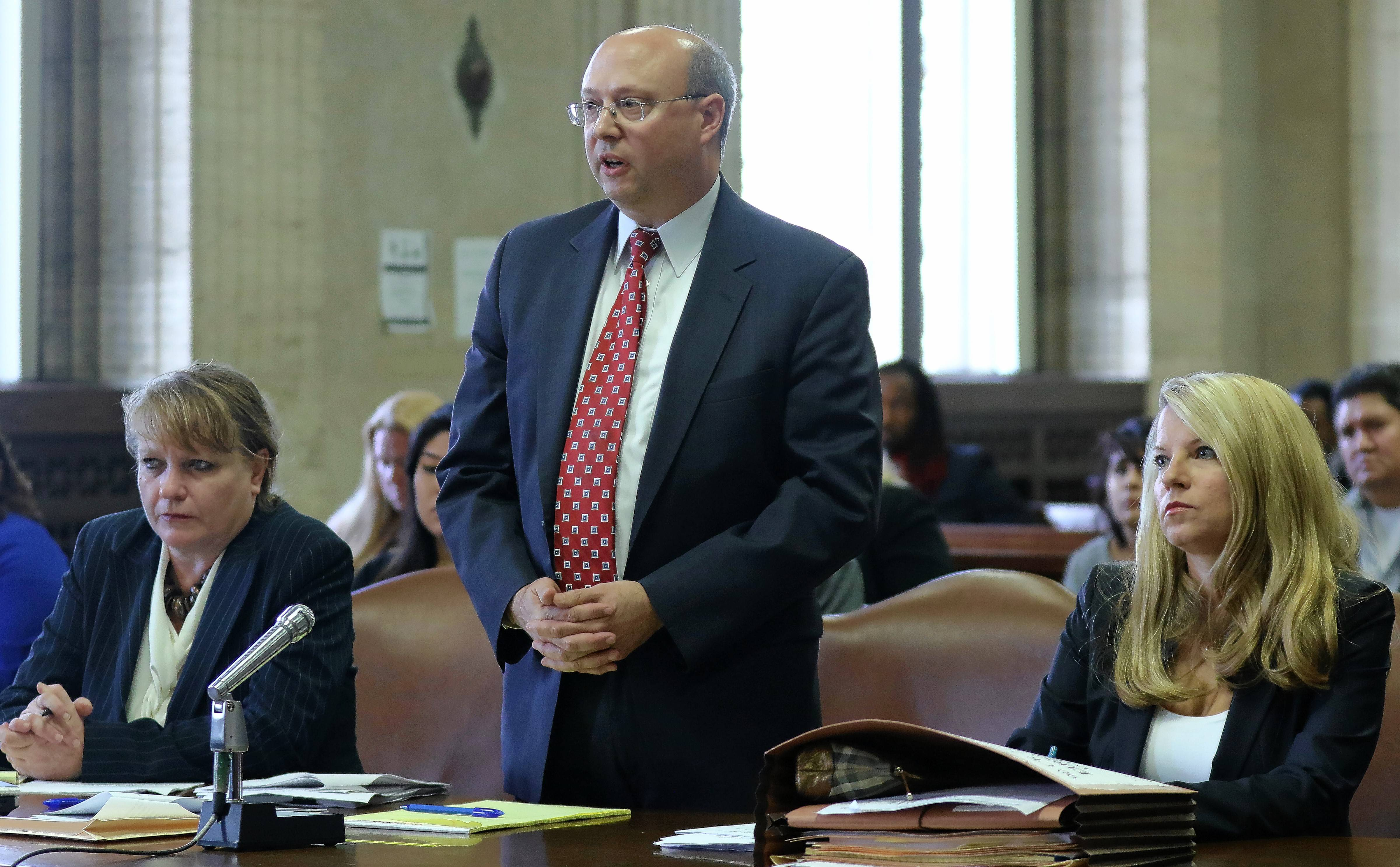 Cook County assistant state's attorney Alan Spellberg delivers arguments as fellow prosecutors Celeste Stack, left, and Jane Sack, right, listen during a hearing Nov. 5 at the Leighton Criminal Court Building in Chicago for the upcoming resentencing of David Biro.