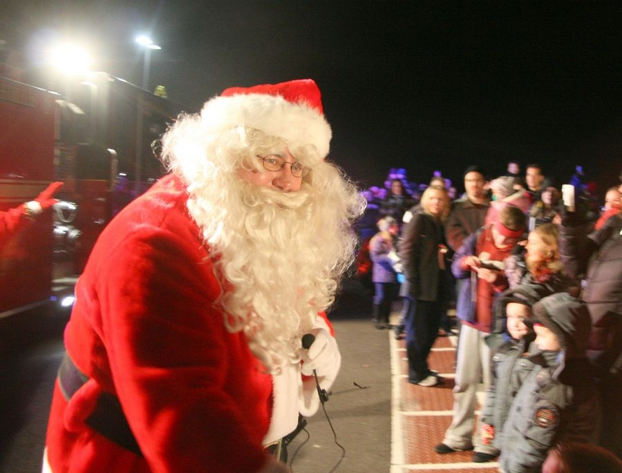 Santa Claus greets a crowd gathered to welcome him after arriving on a firetruck for the 2011 Festival of Trees and Santa Ride In at Lake in the Hills village hall. This year's festival kicks off Friday.