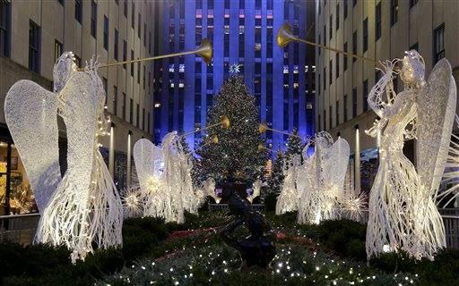 The Rockefeller Center Christmas tree stands lit during the lighting ceremony Wednesday Dec. & Heightened security amid Rockefeller Christmas Tree lighting azcodes.com