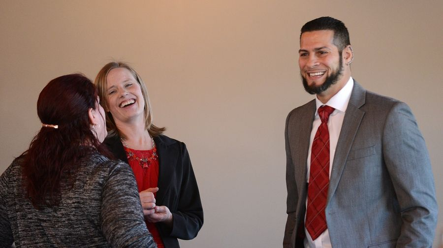 Juan Rivera laughs while talking with Kristine Bunch, left, and Kane County Assistant Public Defender Kim Bilbrey during a break at a workshop Friday in Geneva to examine four wrongful convictions. Rivera and Bunch both were wrongfully convicted of crimes.