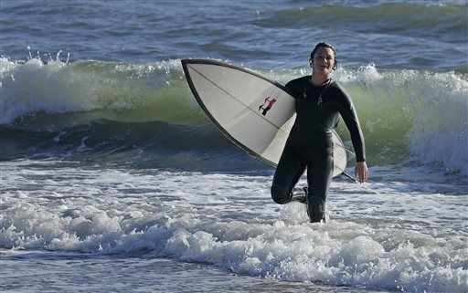 e0e8bb57a38f7f Bianca Valenti walks in from the ocean after surfing waves at Mavericks  Friday