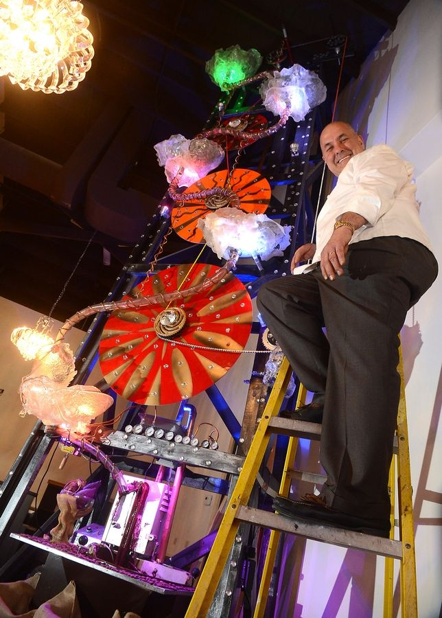 Chef Alain Roby with the 20-foot-tall chocolate rig that is the centerpiece of his new restaurant.