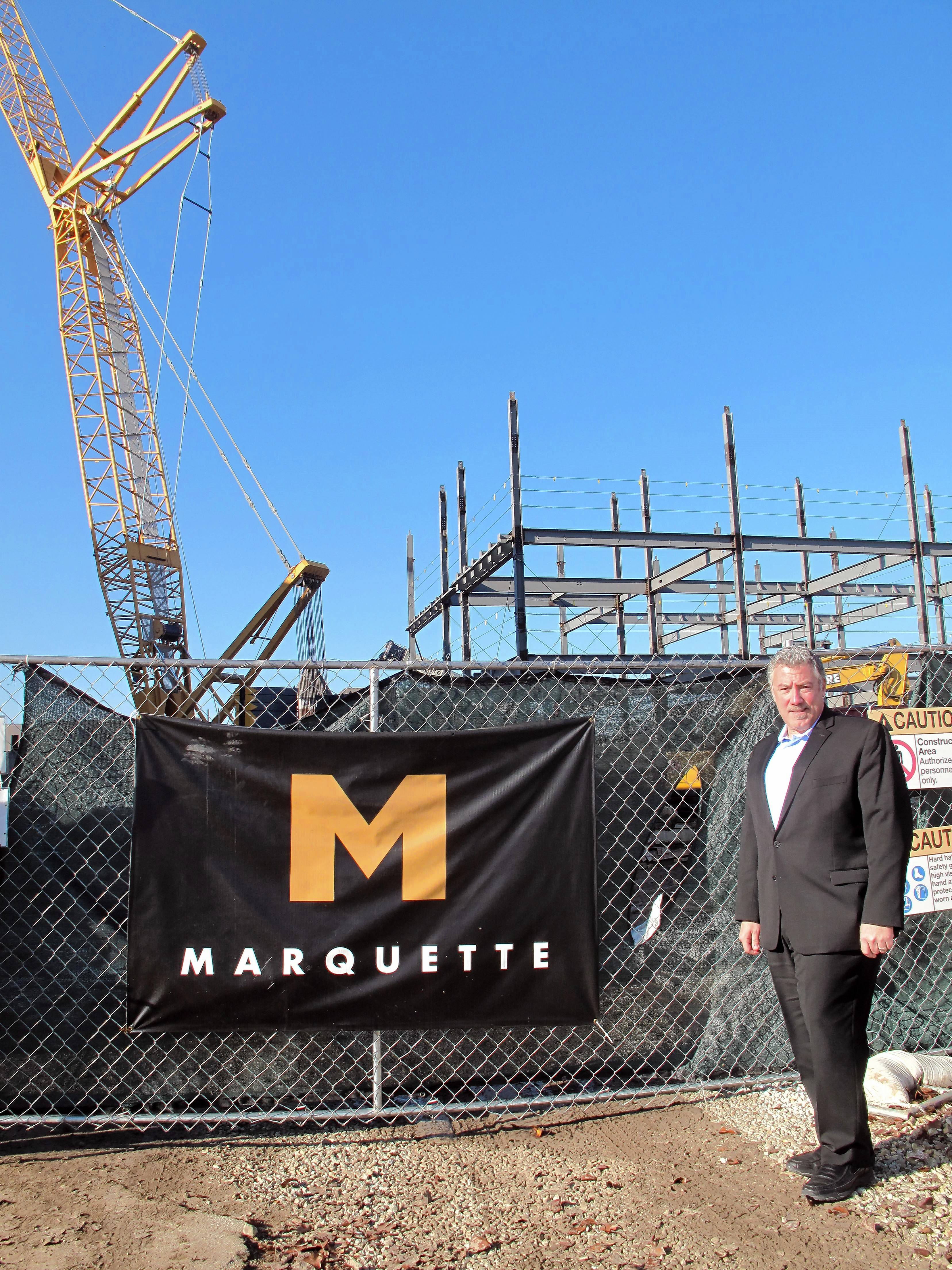 Jeff Prosapio, executive vice president of development for Marquette Companies, watches daily progress on the Water Street District from his office next to the construction site at Main and Water streets in downtown Naperville.