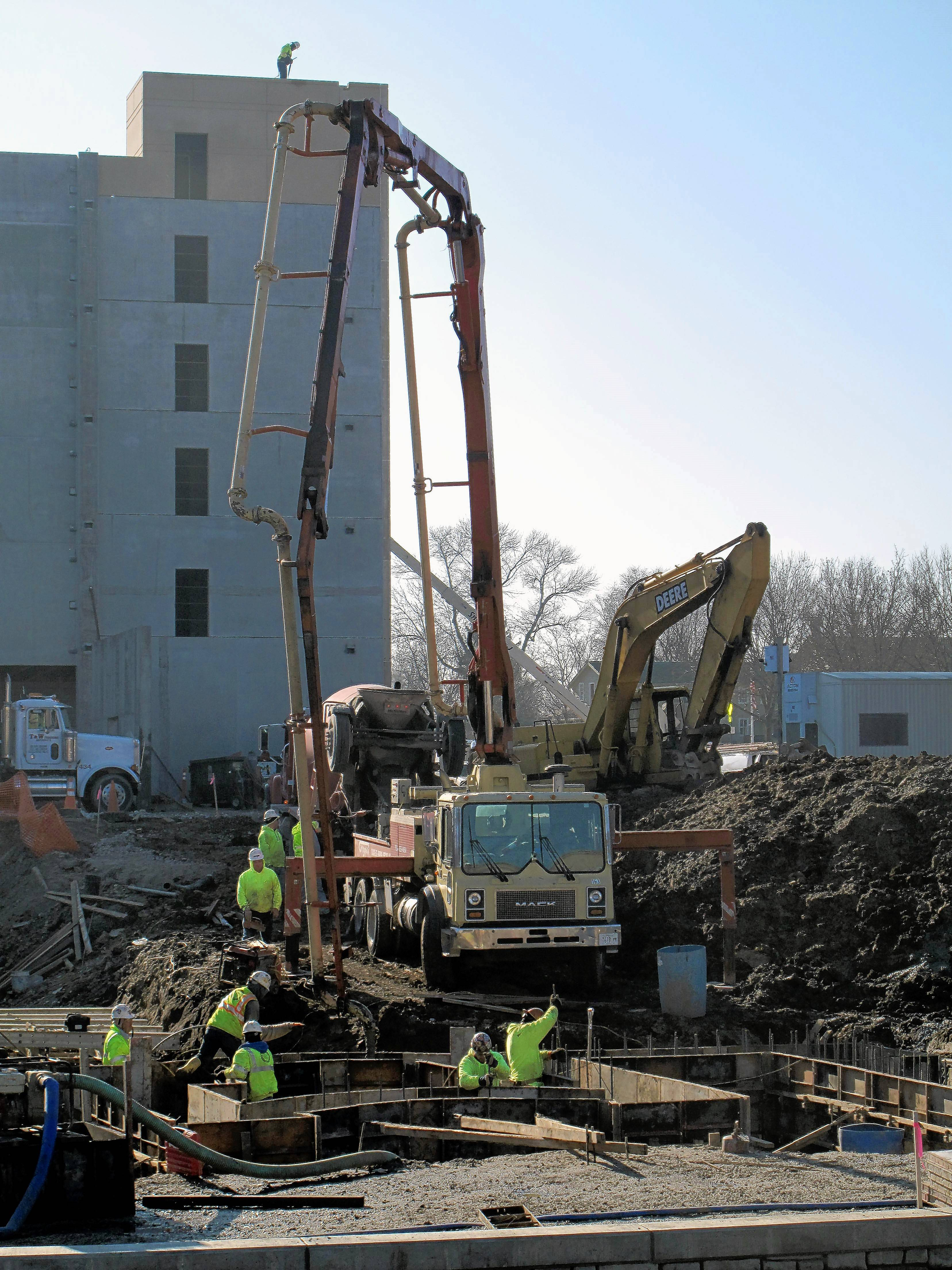 Workers dig the foundation for one of the buildings of the Water Street District in downtown Naperville.