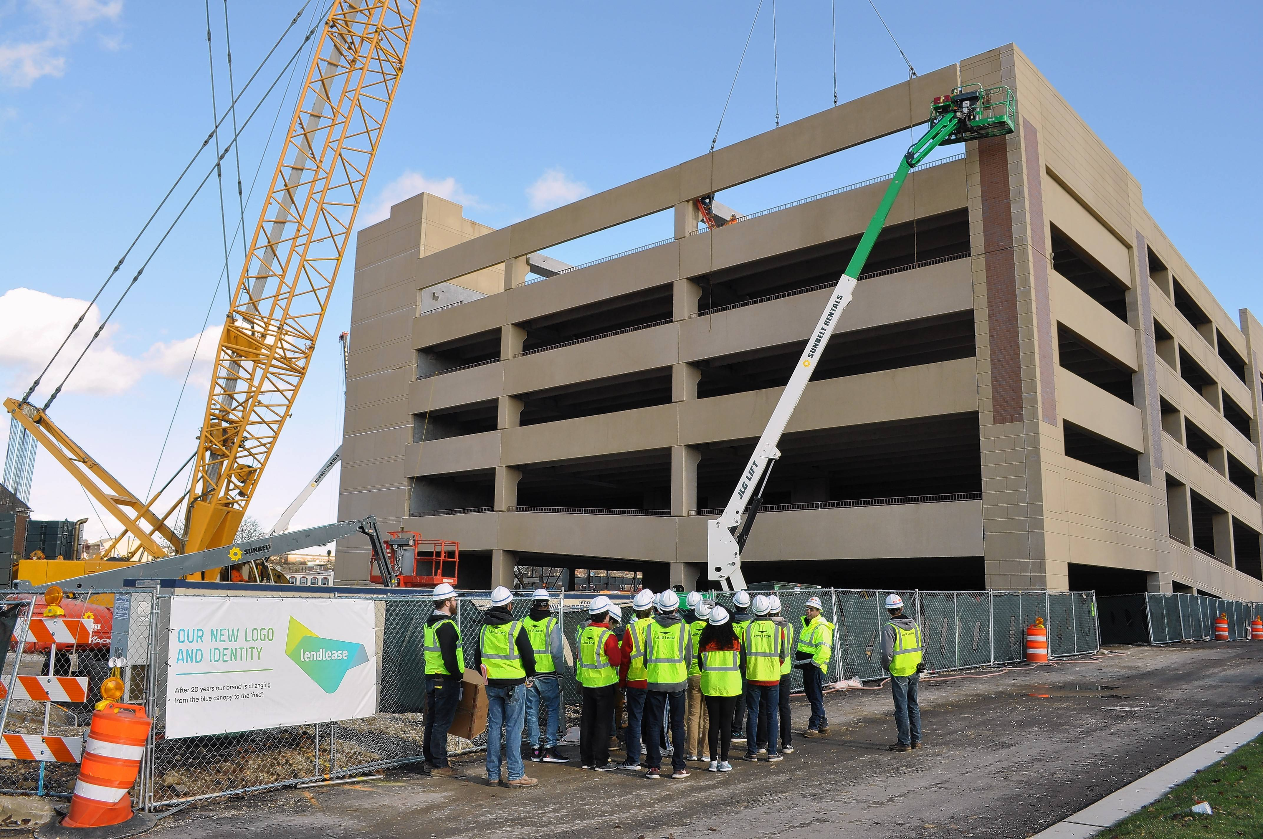 Students in architecture and engineering classes at Naperville North High School take a tour of the Water Street District construction site, where a parking garage, hotel, restaurants, shops and offices are taking shape.