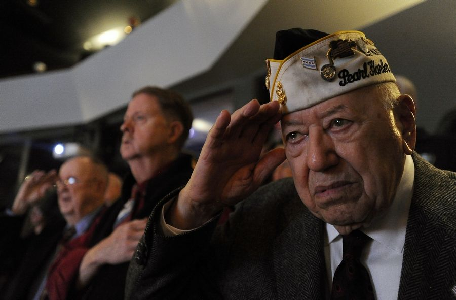 Pearl Harbor survivor Joe Triolo, 95, of Zion salutes during a remembrance ceremony at Prairie Lakes Theater in Des Plaines.