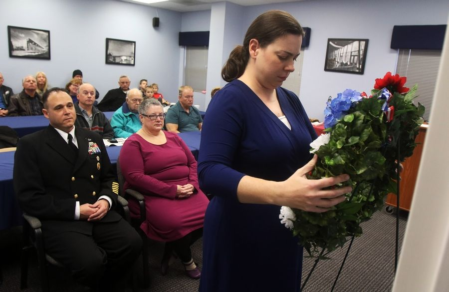 Jennifer Seracy lays a wreath during a Pearl Harbor commemoration ceremony Monday at the Great Lakes Naval Museum near North Chicago. The presentation honored those killed during the Dec. 7, 1941, attack.